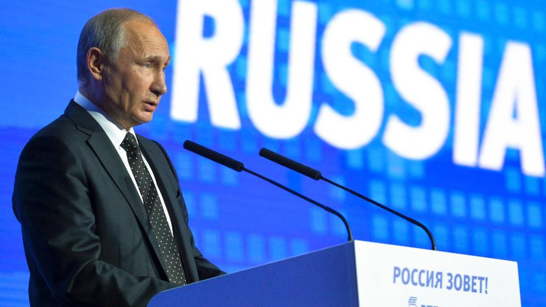 """Russian President Vladimir Putin speaks at the 8th annual VTB Capital """"Russia Calling!"""" Investment Forum in in Moscow, Russia, Wednesday, Oct. 12, 2016.Russia's economy has been on its way down since it slipped into recession at the start of last year. (Alexei Druzhinin, Sputnik,  Kremlin Pool Photo via AP)"""
