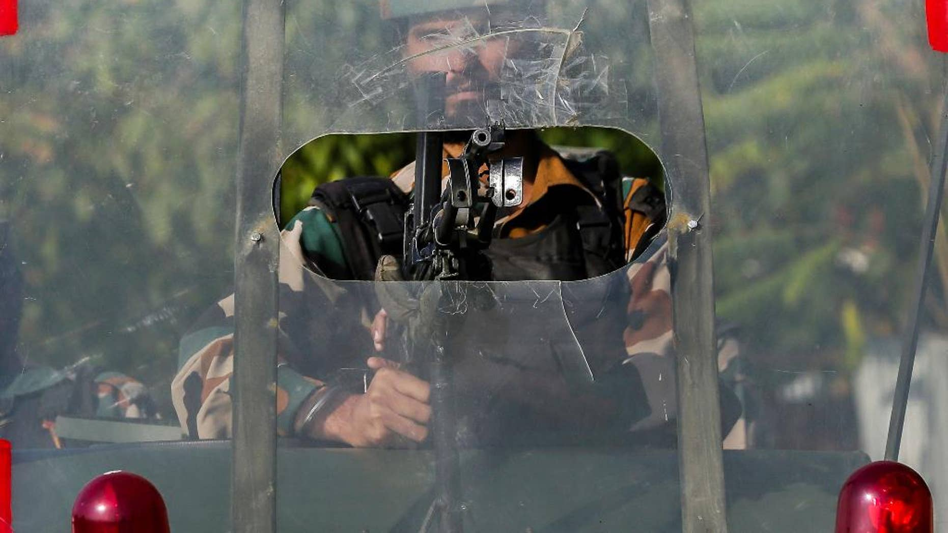 An Indian army soldier guards outside the base camp which was attacked by suspected militants at Baramulla, northwest of Srinagar, Indian controlled Kashmir, Monday, Oct. 3, 2016. A gun battle with a group of militants who attacked an Indian army camp in the Indian portion of Kashmir has ended early Monday morning, police said. (AP Photo/Mukhtar Khan)