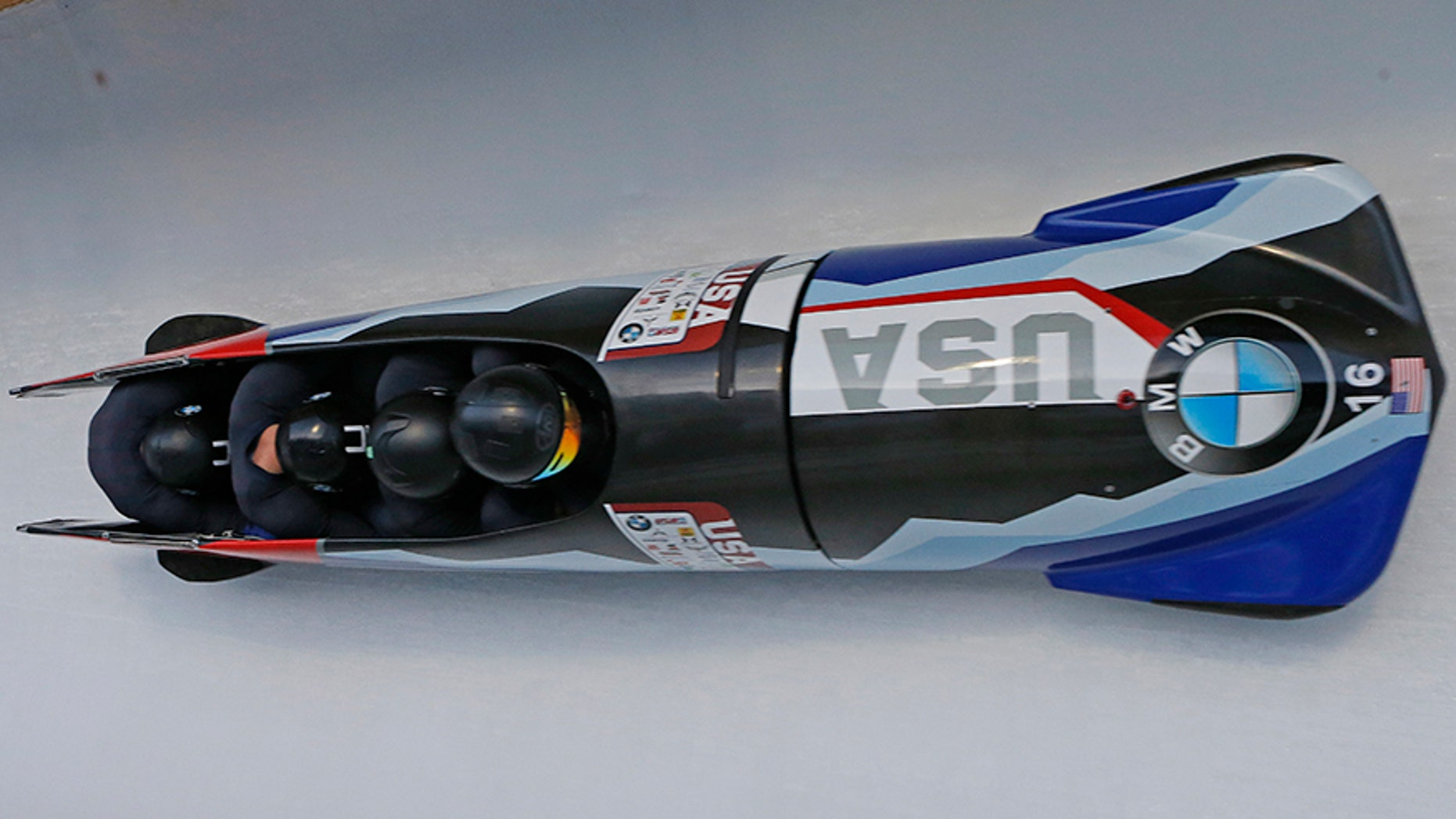 In this Nov. 18, 2017, file photo, pilot Codie Bascue, front, Nathan Weber, Carlo Valdes and Samuel McGuffie, of the United States, compete in the four-man bobsled World Cup race in Park City, Utah.