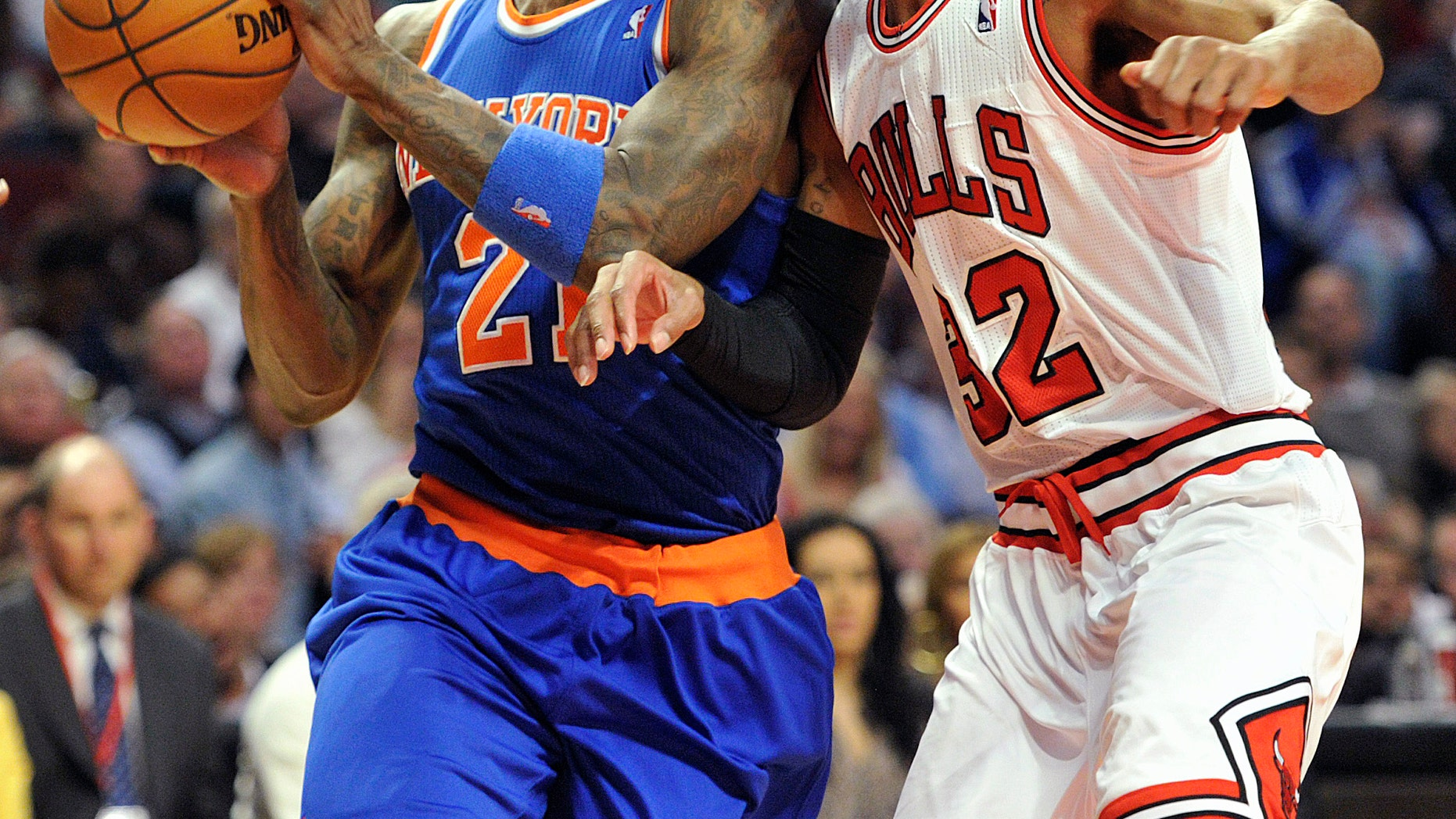 New York Knicks' Iman Shumpert drives to the basket as Chicago Bulls' Richard Hamilton (32) defends during the first half of an NBA basketball game, Thursday, April 11, 2013, in Chicago. (AP Photo/Jim Prisching)