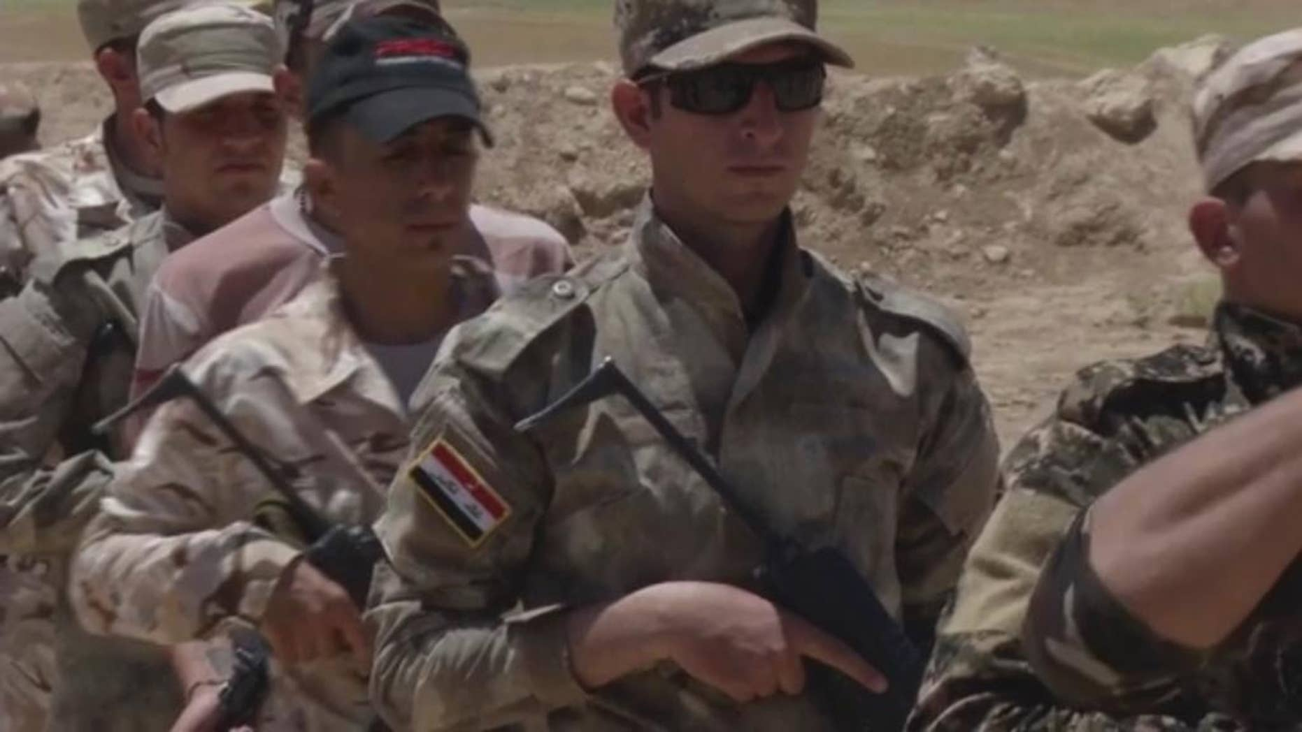 In this video grab made on Tuesday, June 14, 2016, in Alqoosh, Iraq, shows Assyrian Christian militiamen during a training. The group also know as the Nineveh Plain Protection Units, or NPU, are one of three Christian armed groups who are hoping for American support after the U.S. House of Representatives called for direct assistance to be delivered to local security forces in the north of Iraq. (AP Photo/ Balint Szlanko)