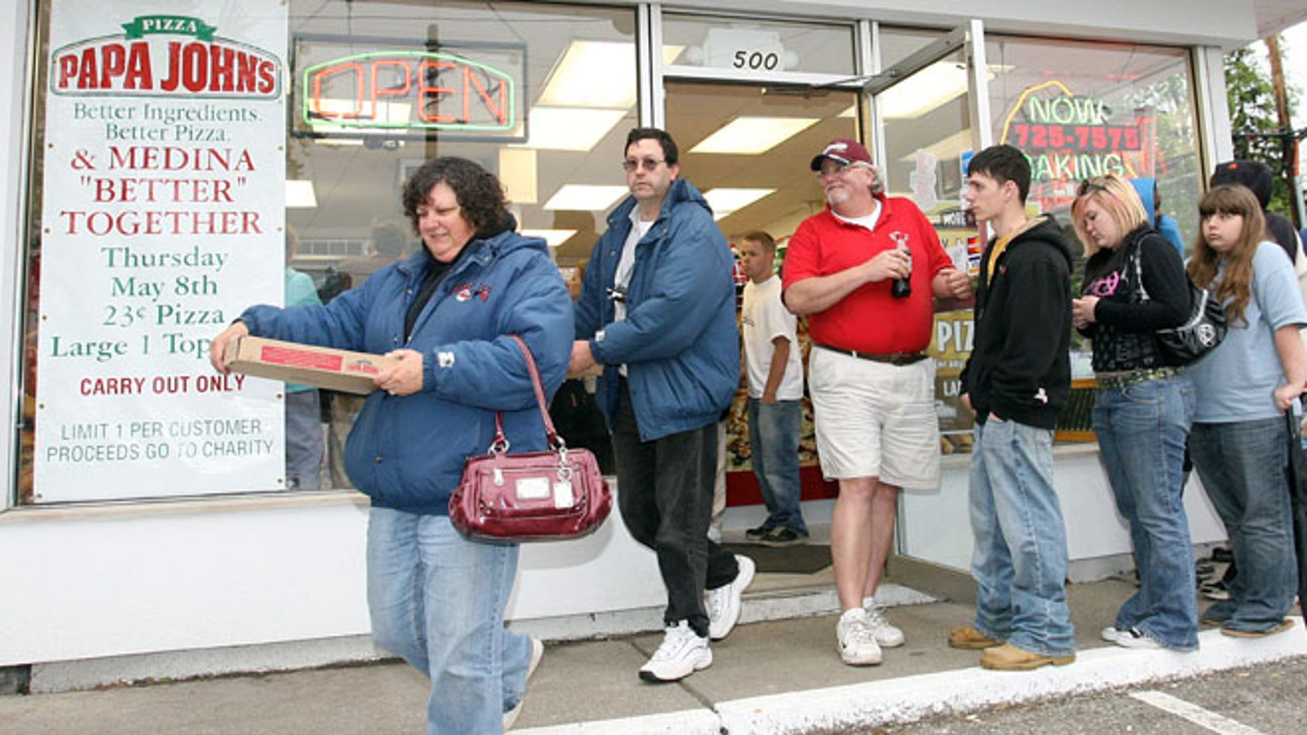 FILE: May 8, 2008: People leave a Papa John's store with pizzas they purchased for 23 cents in Medina Ohio .