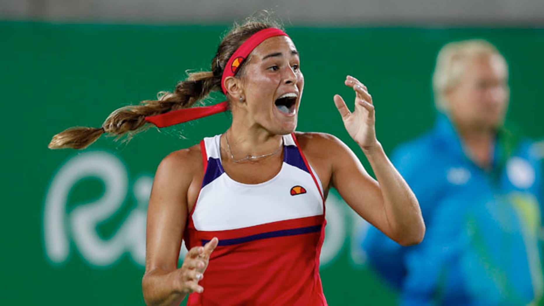 Monica Puig of Puerto Rico reacts after winning the final point of the gold medal match in the women's tennis competition at the 2016 Summer Olympics in Rio de Janeiro, Brazil, Saturday, Aug. 13, 2016. (AP Photo/Vadim Ghirda)
