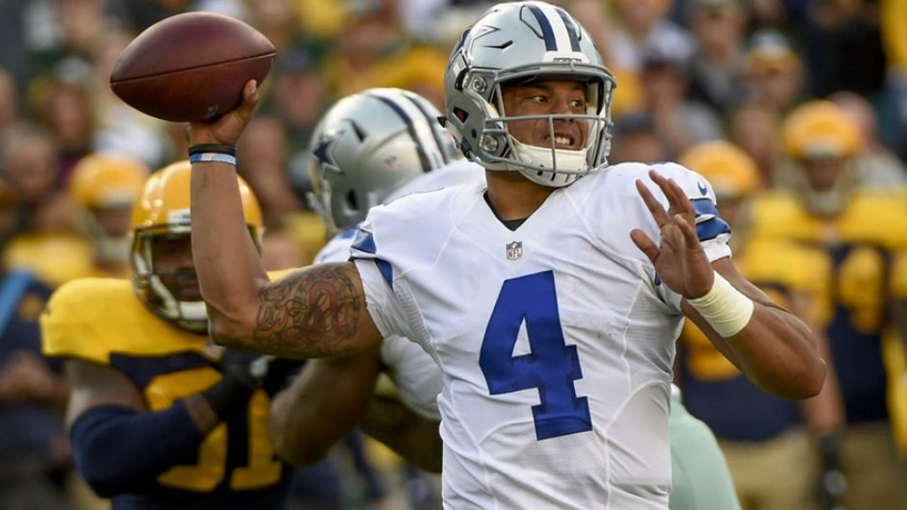 Dallas Cowboys quarterback Dak Prescott said he's ignoring the backlash he's received over his opposition to taking a knee during the anthem.