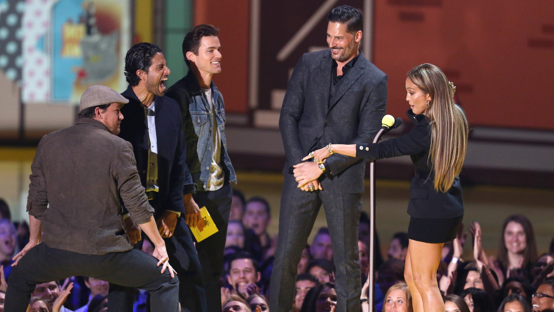 Channing Tatum, from left, Adam Rodriguez, Matt Bomer, and Joe Manganiello present Jennifer Lopez with the award for best scared-as-s**t performance at the MTV Movie Awards at the Nokia Theatre on Sunday, April 12, 2015, in Los Angeles. (Photo by Matt Sayles/Invision/AP)