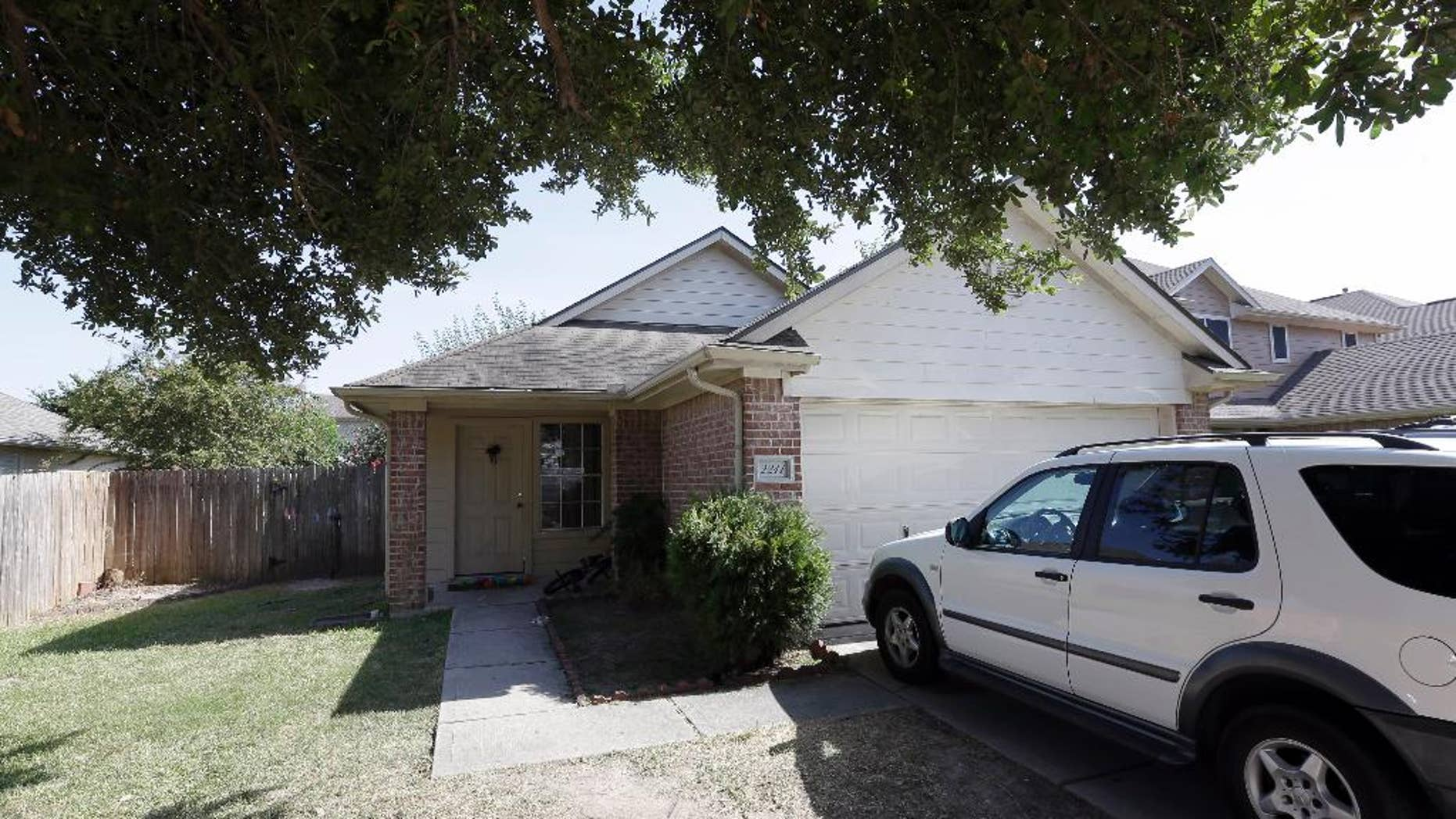 A house is shown, Sunday, Aug. 9, 2015, where eight people were killed on Saturday in Houston. A family of six children and two parents were handcuffed and fatally shot in the head at a Houston home by a man with a violent criminal history who had previously been in a relationship with the mother and had a dispute with her, authorities said Sunday. David Conley, 48, was charged with capital murder in the deaths. (AP Photo/David J. Phillip)