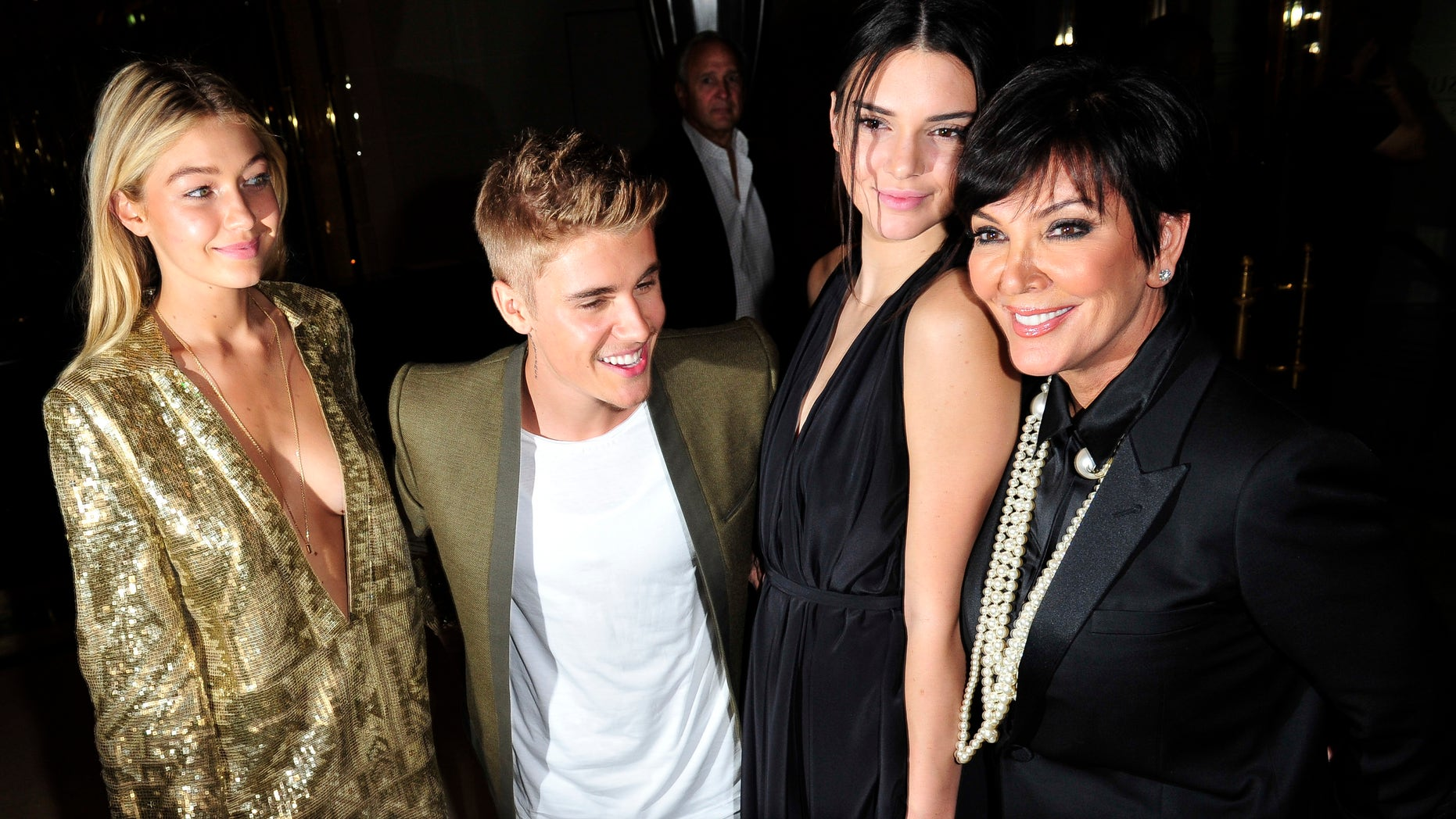 Gigi Hadid, Justin Bieber, Kendall Jenner, and Kris Jenner in Paris, Tuesday, Sept. 30, 2014.