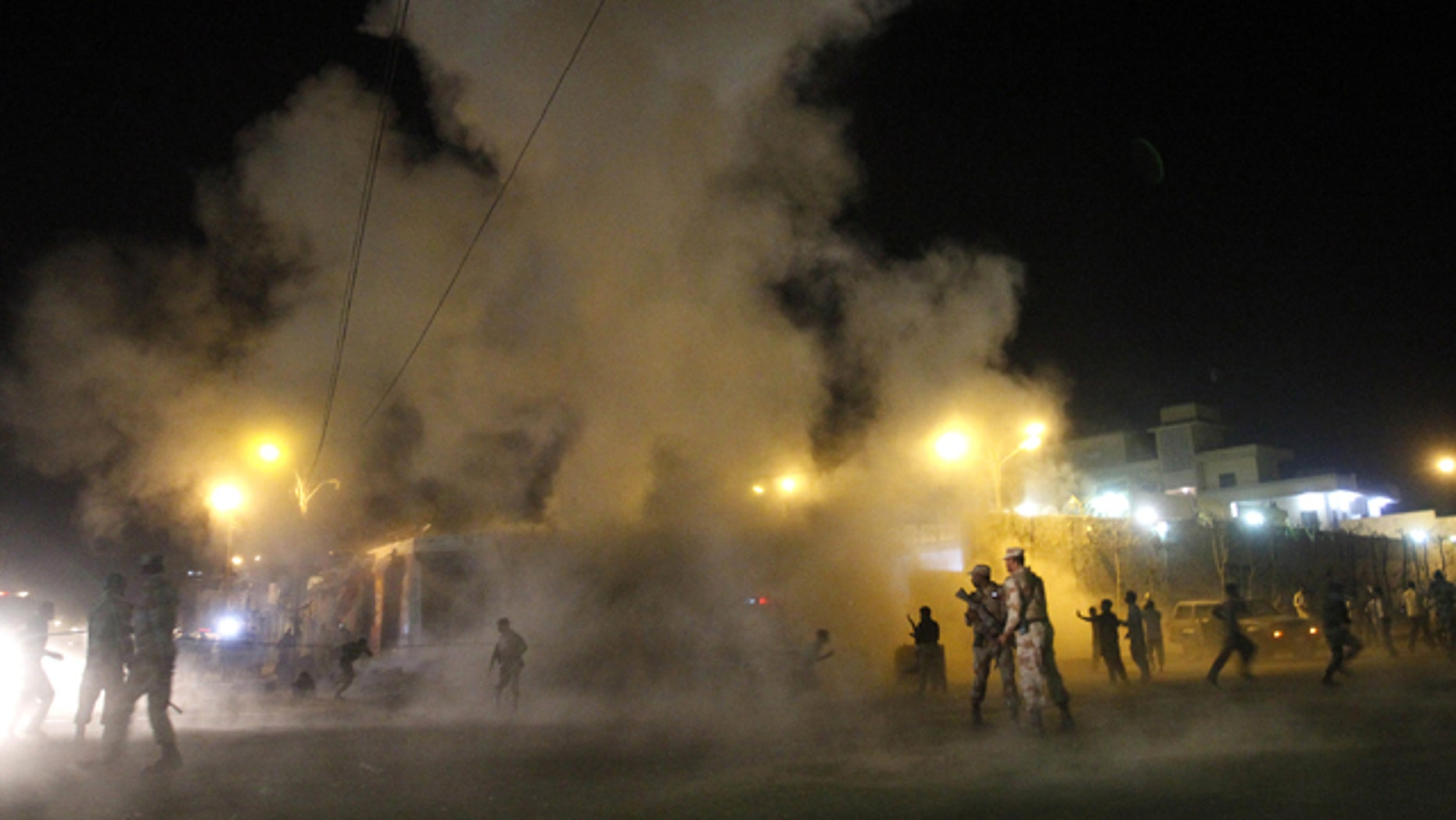 Nov. 21, 2012: People run away after a second blast outside a Shiite mosque during a mourning congregation in Karachi, Pakistan.