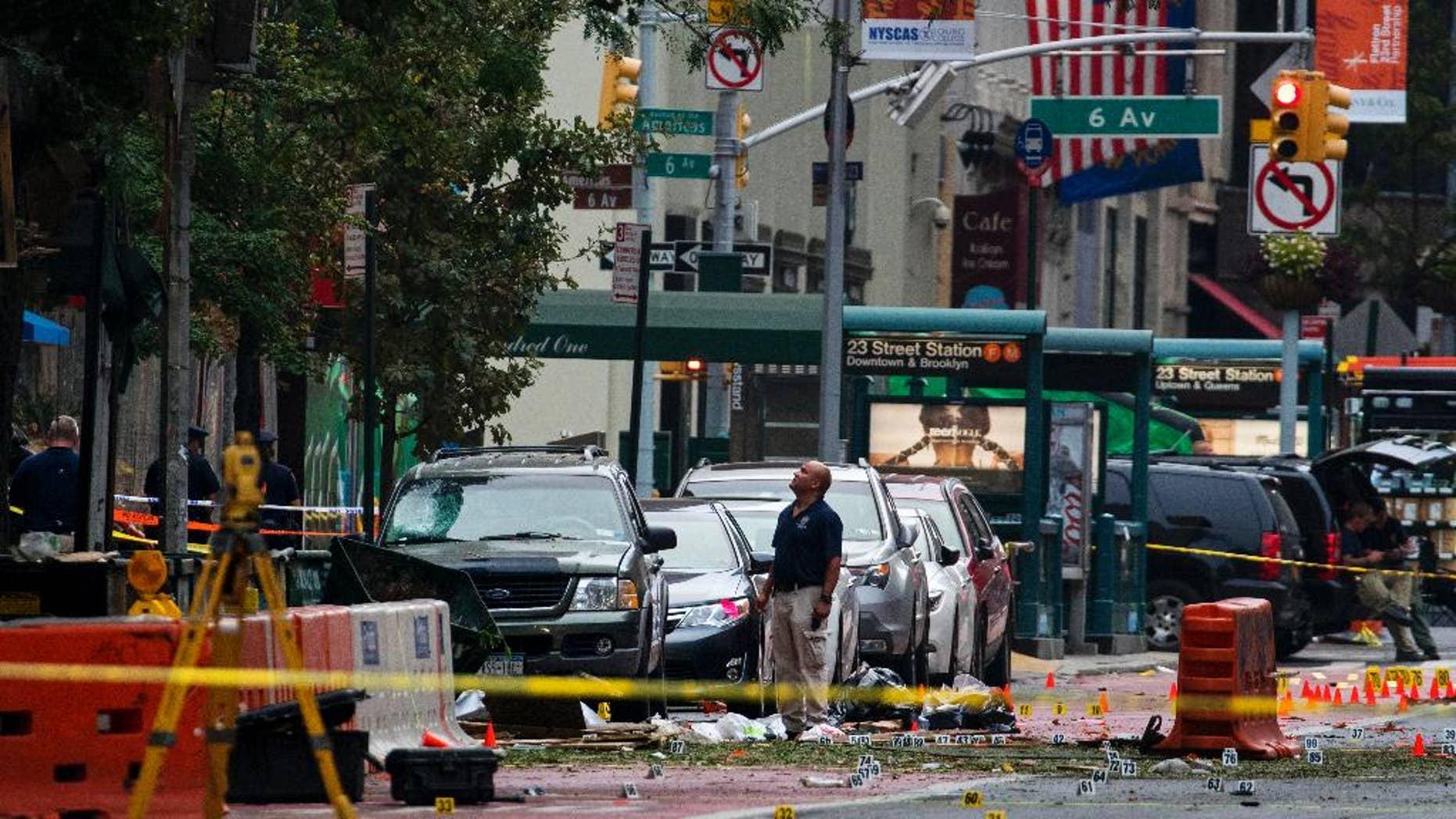 Sept. 18, 2016: Crime scene investigators work at the scene of Saturday's explosion in Manhattan's Chelsea neighborhood, in New York.