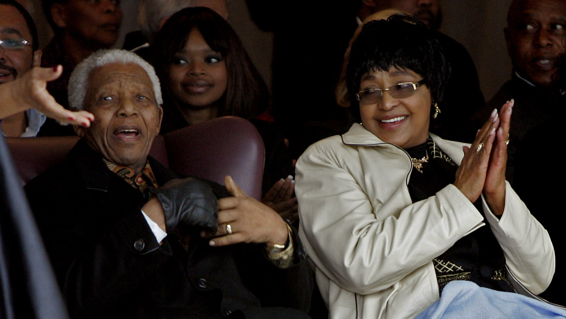 "FILE  - In this Thursday, Aug. 21, 2008 file photo former president Nelson Mandela, left, and his ex-wife Winnie Madikizela-Mandela, right, during the unveiling of a statue of Mandela at the Drakenstein Prison near Franschhoek, South Africa. Madikizela-Mandela told a South African newspaper published Sunday Nov. 17, 2013, that Mandela, remains ""quite ill"" and unable to speak because of tubes that are keeping his lungs clear of fluid, though he is relaxed. (AP Photo/Schalk van Zuydam-File)"
