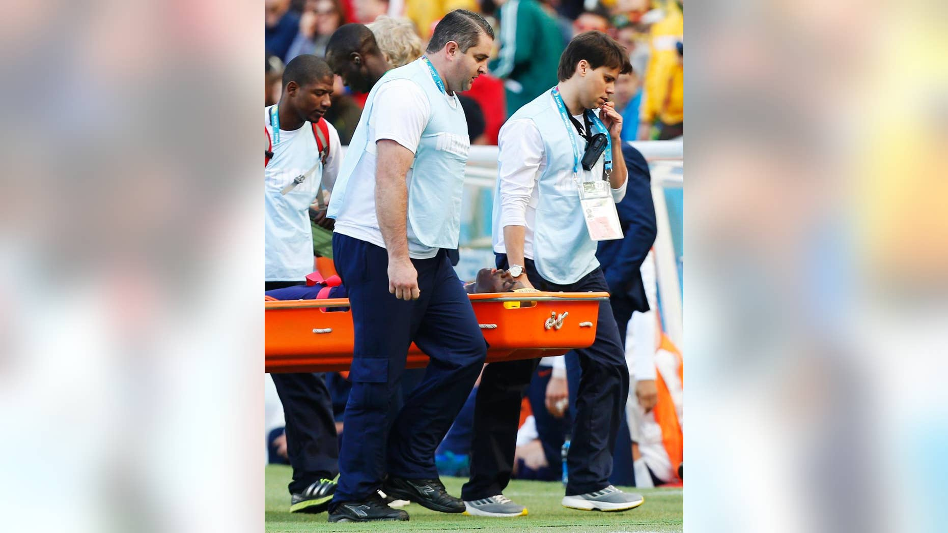 Netherlands' Bruno Martins Indi is carried off the pitch in a stretcher after a collision with Australia's Tim Cahill during the group B World Cup soccer match between Australia and the Netherlands at the Estadio Beira-Rio in Porto Alegre, Brazil, Wednesday, June 18, 2014.  (AP Photo/Jon Super)