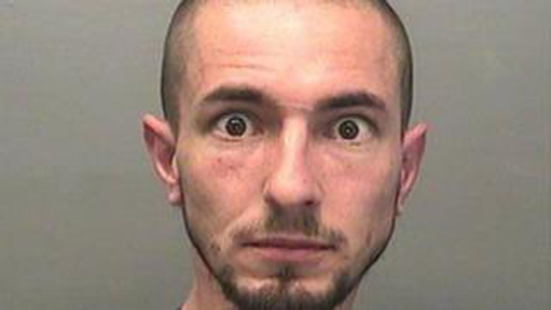 Wayne Esmonde, 35, wanted this mugshot removed from the South Wales Police's Facebook page.