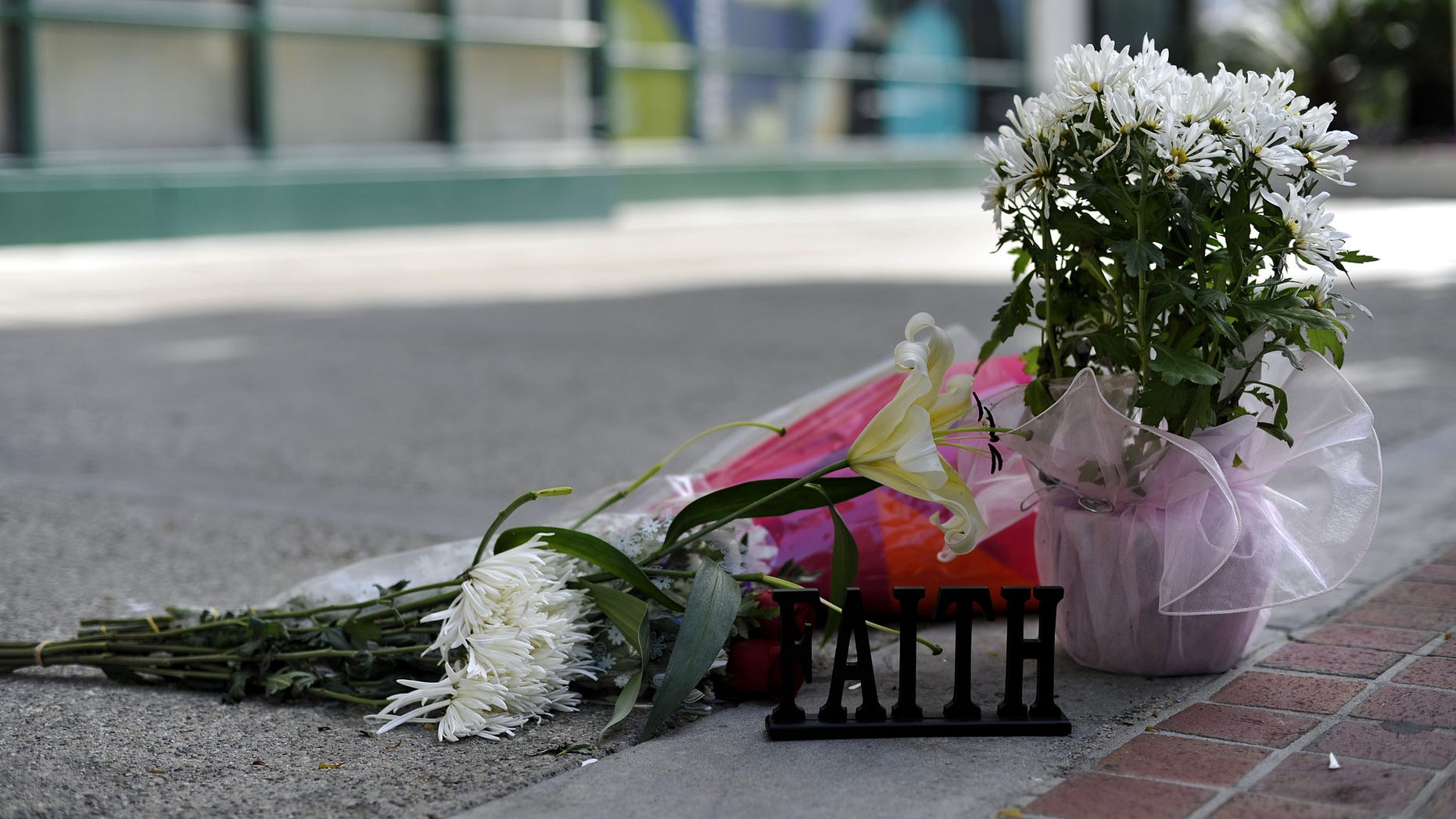 LOS ANGELES, CA - FEBRUARY 28: Flowers are placed in front of the building at the 900 block of South Flower Street where Marie Osmonds son Michael Blosil committed suicide on February 28, 2010 in Los Angeles, California. (Photo by Toby Canham/Getty Images)