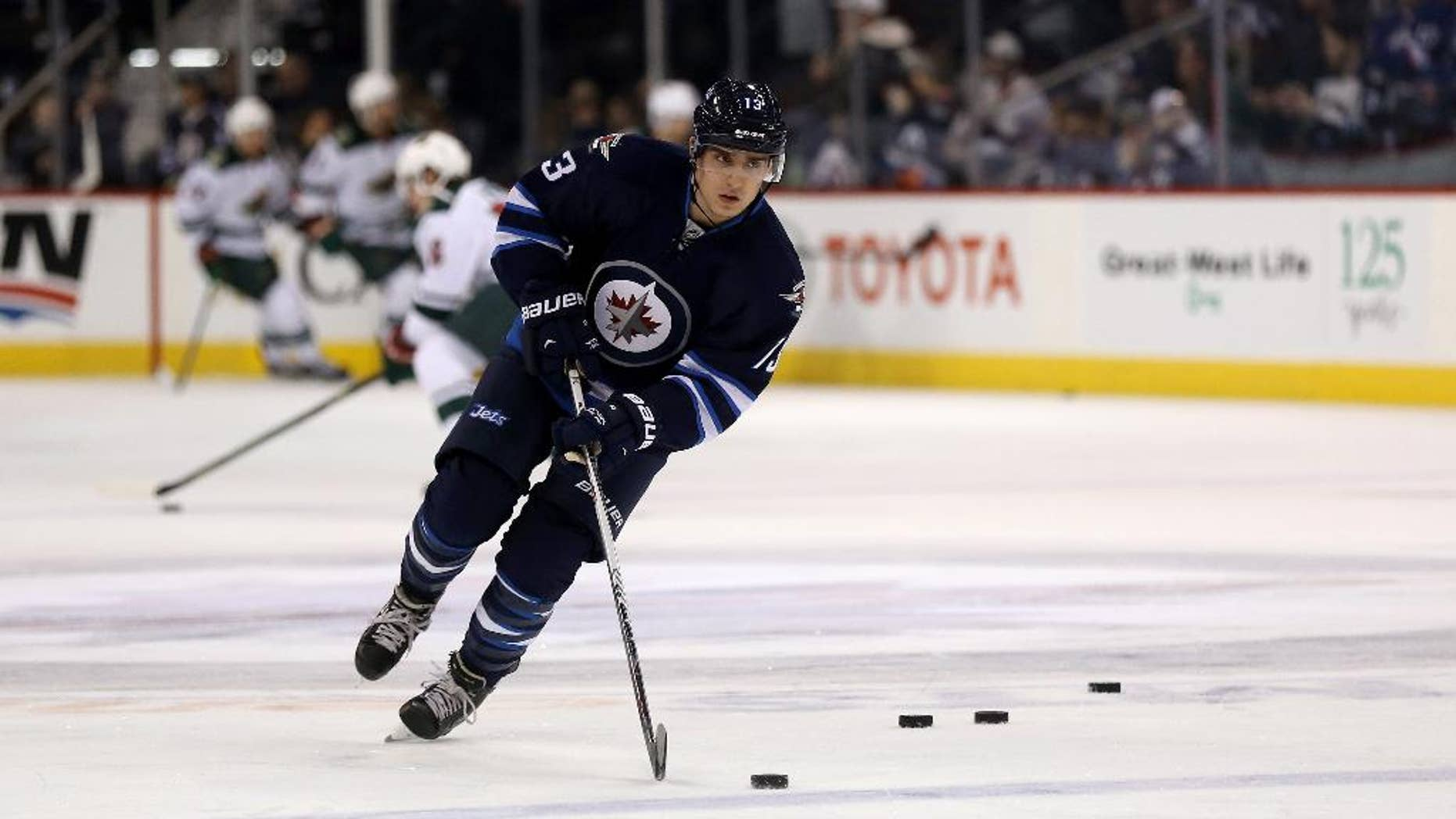 Winnipeg Jets' Brandon Tanev (13), newly signed from Providence College, attends warmups prior to NHL hockey action against the Minnesota Wild in Winnipeg, Manitoba, Sunday, April 3, 2016. (Trevor Hagan/The Canadian Press via AP) MANDATORY CREDIT