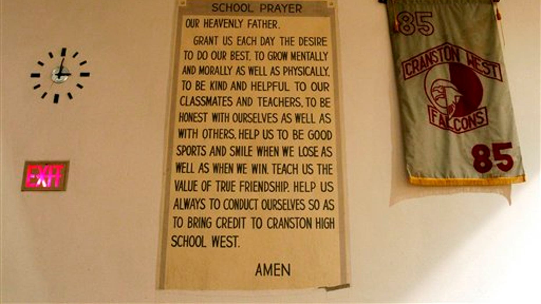 October 13: A prayer banner is seen on the wall of an auditorium at Cranston High School West, in Cranston, R.I.