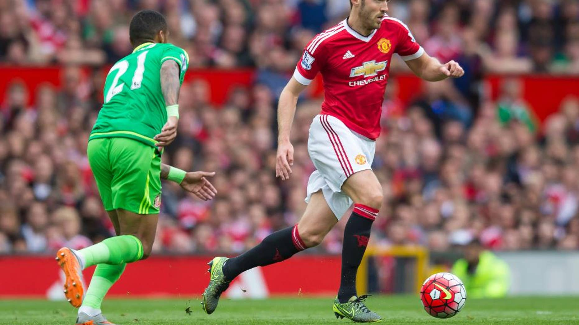 FILE - This is a Saturday, Sept. 26, 2015  file photo of Manchester United's Michael Carrick, right, as he fights for the ball against Sunderland's Yann M'Vila during the English Premier League soccer match between Manchester United and Sunderland at Old Trafford Stadium, Manchester, England.  Amid the likely rotation during the 2016 busy festive program in the Premier League, there's one player Manchester United fans won't want to see out of the team and that player is Michael Carrick (AP Photo/Jon Super, File)