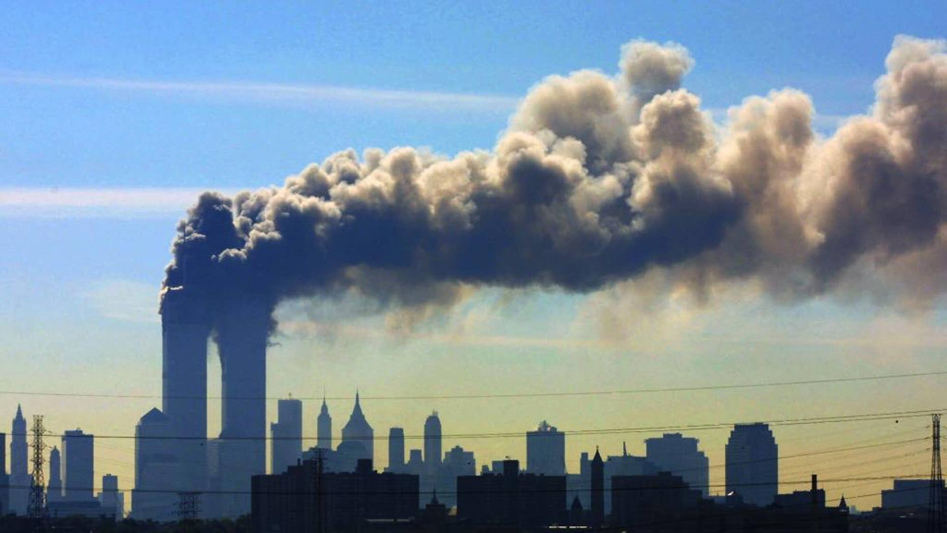 Smoke billows from the twin towers of the World Trade Center in New York after airplanes crashed into both towers on Sept. 11, 2001.