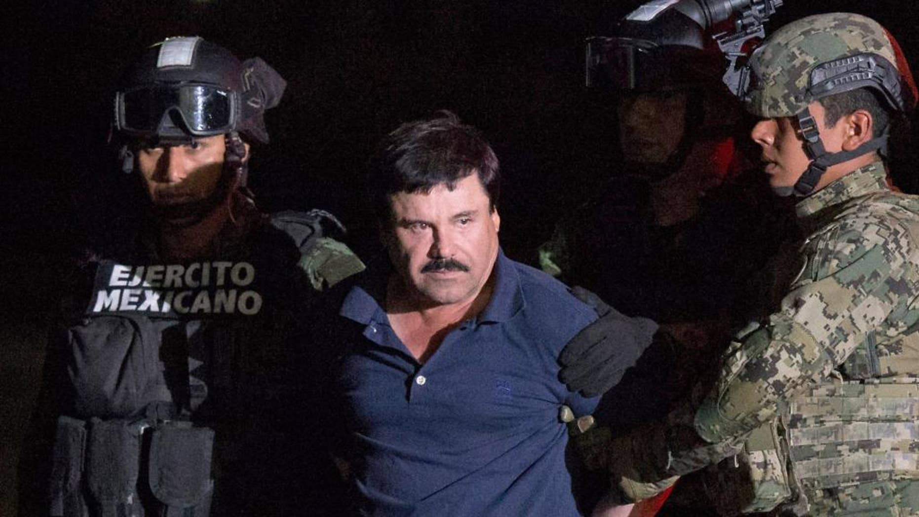 """FILE - In this Jan. 8, 2016 file photo, Mexican drug lord Joaquin """"El Chapo"""" Guzman is escorted by soldiers to a waiting helicopter at a federal hangar in Mexico City, after he was recaptured from breaking out of a maximum security prison in Mexico. A Mexican judge said on Monday, May 9, 2016 that Guzman's extradition to the U.S. can move ahead, but the country's foreign ministry must still approve it and the defense can appeal. (AP Photo/Rebecca Blackwell, File)"""