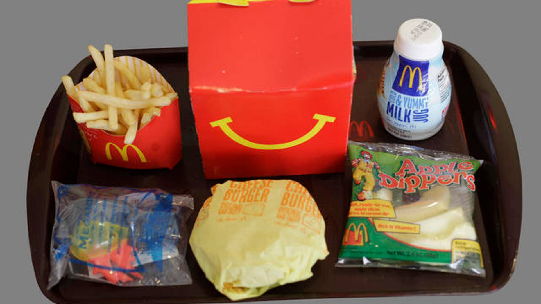 Shown is a Happy Meal at a McDonald's restaurant in San Francisco, Monday, Nov. 8, 2010. In the left foreground is a character toy included with the meal from the movie Megamind. It is a happy moment for people who see the Happy Meal as anything but.  San Francisco is poised to become the first major American city to require fast-food restaurants to sell meals that meet set nutritional guidelines or not include a toy with them. (AP Photo/Eric Risberg)