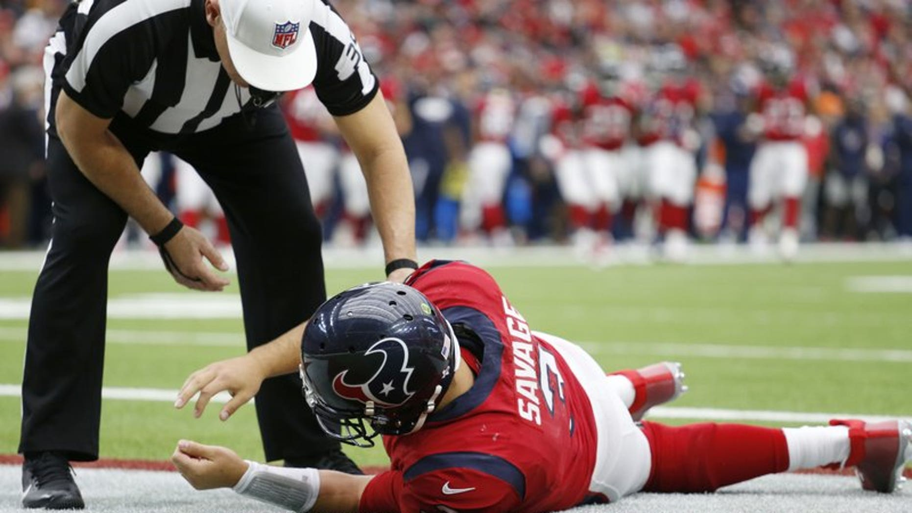 December 10, 2017: Houston Texas quarterback Tom Savage on the ground frollowing a hit during the second quarter of an NFL football game against the San Francisco 49ers.