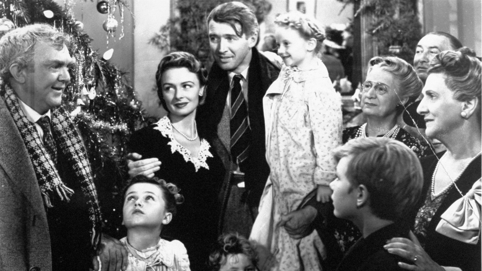 "FILE -  In this 1946 file photo originally provided by RKO Pictures Inc., legendary actor James Stewart as George Bailey, center, is reunited with his wife played by actress Donna Reed, third from left, and family during the last scene of Frank Capra's ""It's A Wonderful Life.""  (AP Photo/RKO Pictures Inc.)"
