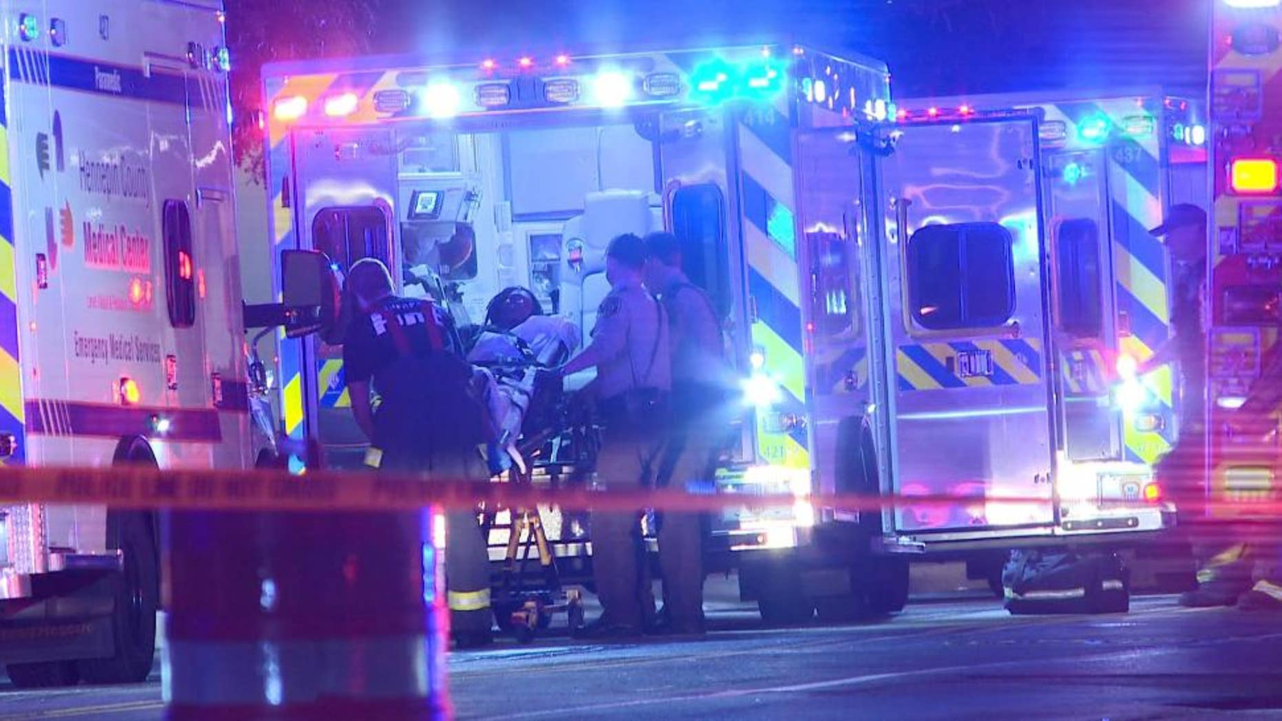 In this photo provided by KARE, a person is brought into an emergency vehicle after a shooting early Monday, Oct. 3, 2016, in Minneapolis. Minneapolis police said multiple people have been wounded in shootings in downtown Minneapolis. (KARE via AP)
