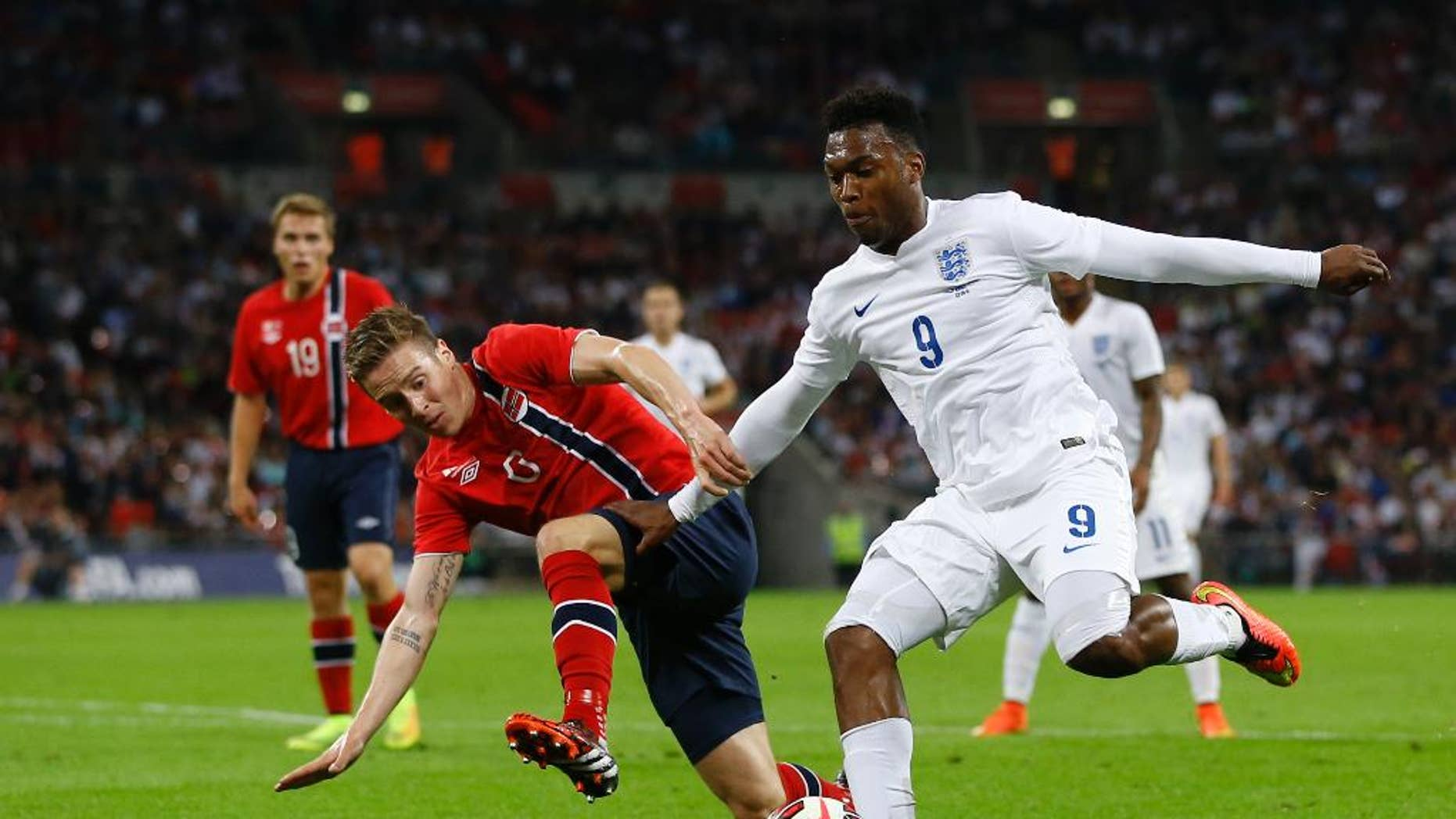 England's Daniel Sturridge, right, vies for the ball with Norway's Stefan Johansen during the international friendly soccer match between England and Norway at Wembley Stadium in London, Wednesday, Sept. 3, 2014. (AP Photo/Kirsty Wigglesworth)