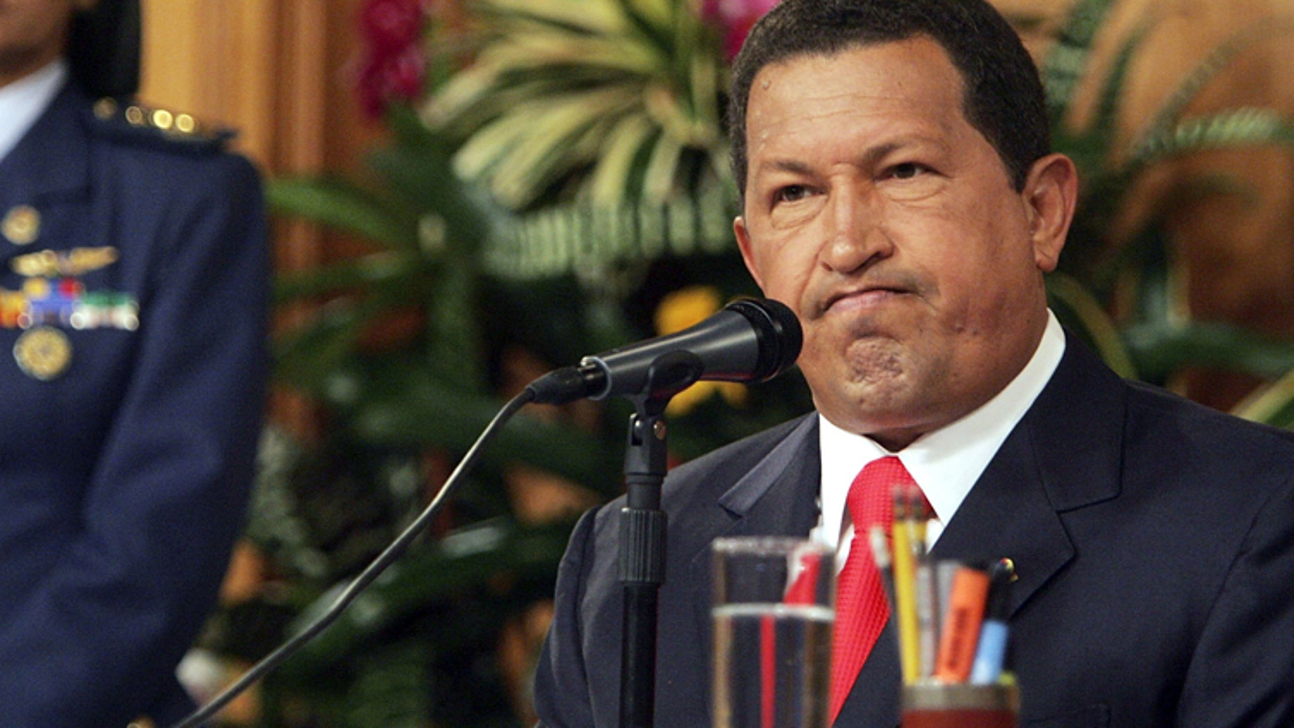 CARACAS, VENEZUELA - NOVEMBER 30:  President Hugo Chavez speaks at a press conference in Miraflores Palace November 30, 2006 in Caracas, Venezuela. Chavez faces off against challenger Manuel Rosales in the presidential election December 3.  (Photo by Mario Tama/Getty Images)