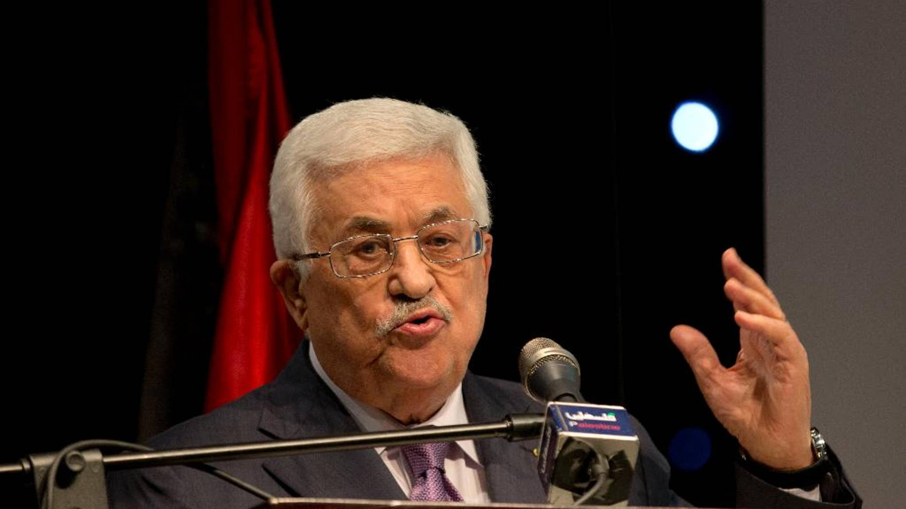 """Palestinian President Mahmoud Abbas speaks during a ceremony of """"Jerusalem In Memory""""?? after the meeting with Secretary General of The Organization of The Islamic Conference Iyad Amin Madani, in the West Bank city of Ramallah, Sunday, Jan. 4, 2015. (AP Photo/Majdi Mohammed)"""