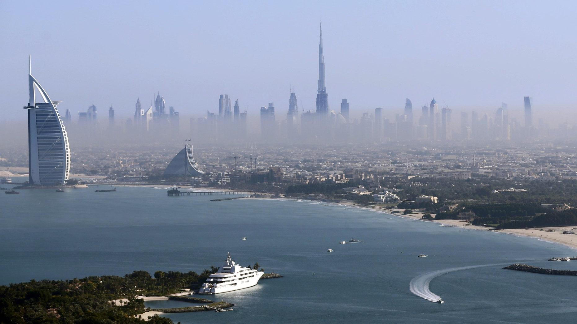 File photo - Burj Khalifa, the world's tallest tower, and luxury Burj al-Arab Hotel (L) are seen in a general view of Dubai, UAE December 9, 2015. (REUTERS/Karim Sahib/Pool)