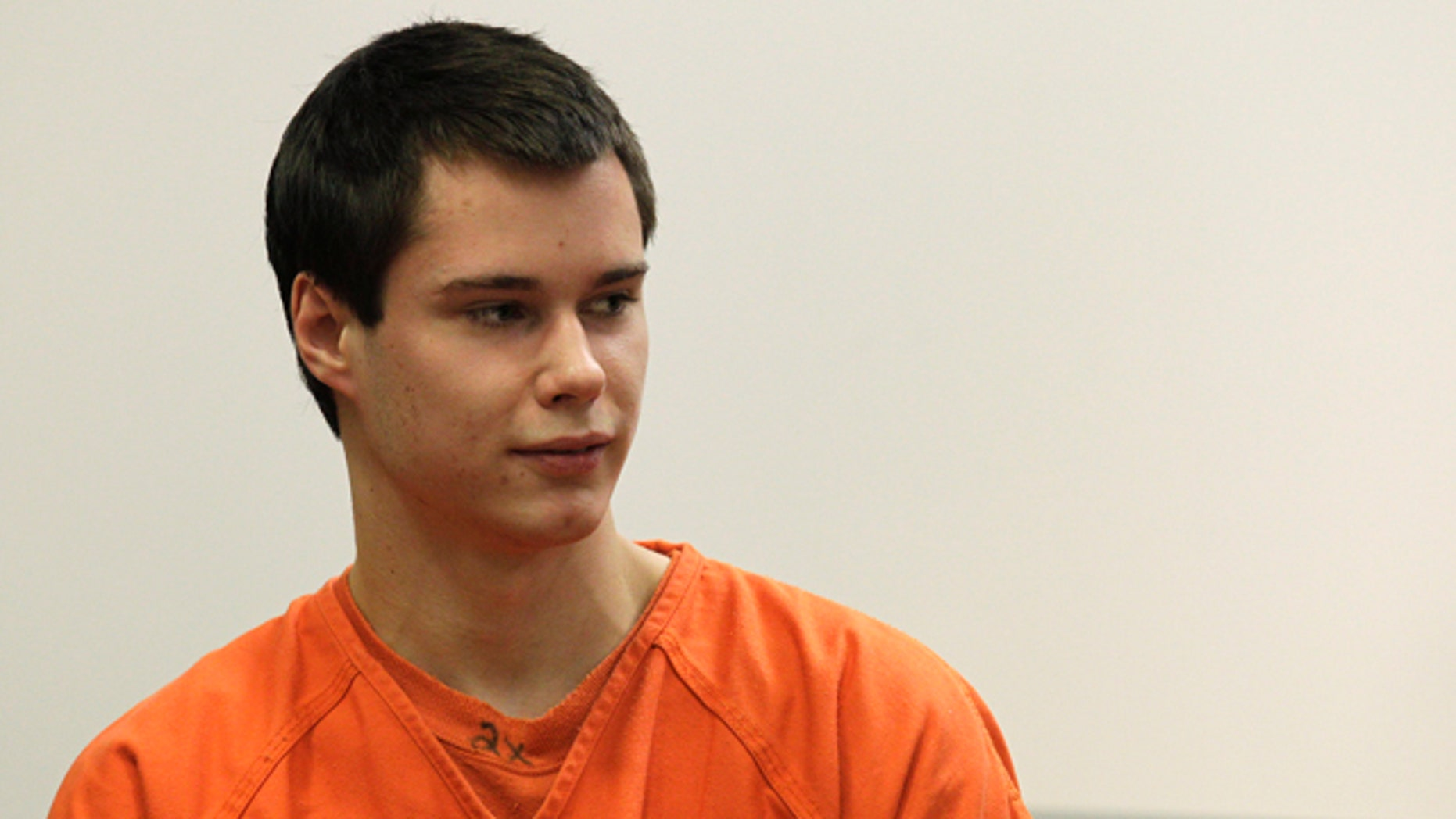 Dec. 16: Colton Harris-Moore, also known as the 'Barefoot Bandit' glances at the courtroom gallery as he walks to the defense table, in Island County Superior Court, in Coupeville, Wash.