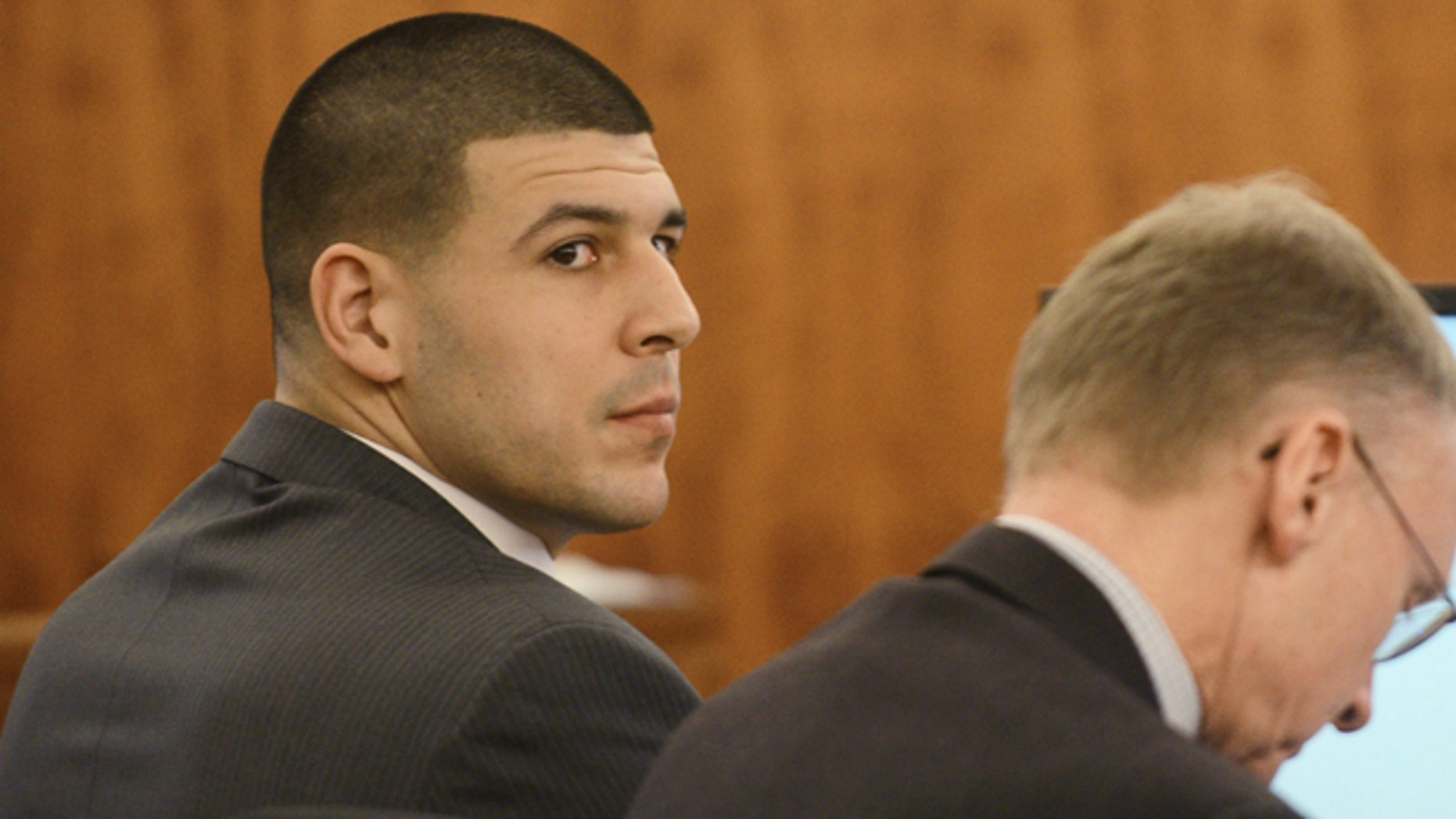 Aaron Hernandez, left, sits with his attorney Charles Rankin during his trial  at Bristol Superior Court on Wednesday, Feb. 11, 2015 in Fall River, Mass. (AP Photo/The Boston Herald, Ted Fitzgerald, Pool)