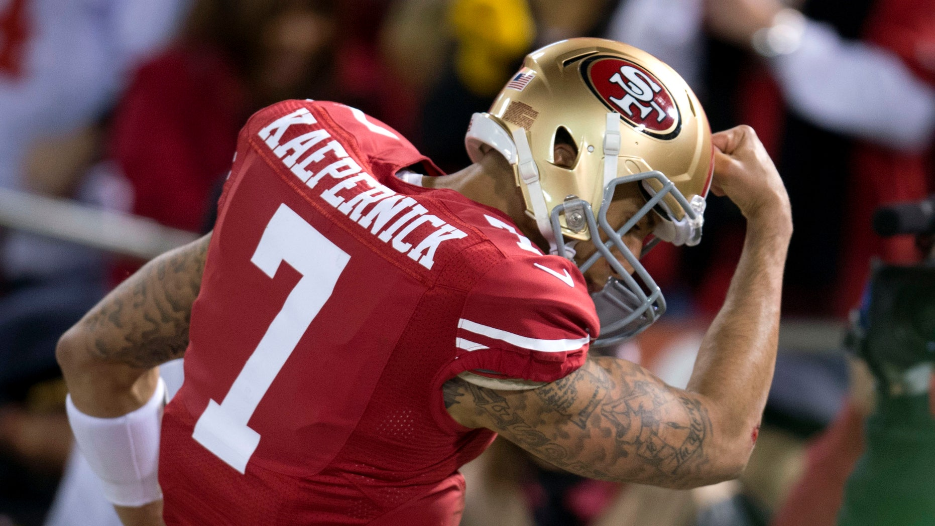 San Francisco 49ers quarterback Colin Kaepernick (7) celebrates his touchdown against the Green Bay Packers during an NFC divisional playoff NFL football game on Saturday, Jan. 12, 2013, in San Francisco. (AP Photo/The Sacramento Bee, Hector Amezcua)