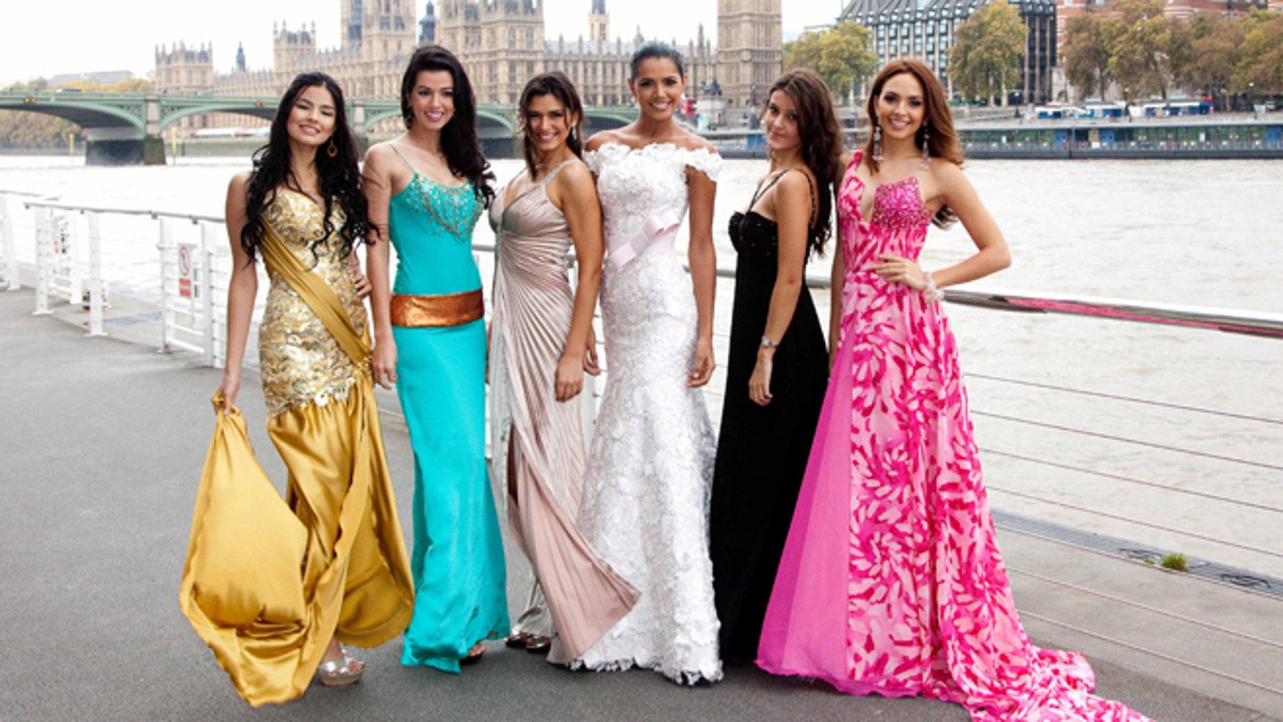 LONDON, ENGLAND - OCTOBER 31:  In this handout provided by Miss World Ltd,  (L-R) Miss Argentina Antonella Kruger, Miss Brazil Juceila Bueno, Miss Chile Gabriela Pulgar Luco, Miss Venuzuela Ivian Sarcos and Miss Columbia Monica Restrepo pose beside the Thames during a photocall as part of the Miss World 2011 UK Tour, on October 31, 2011 in London, United Kingdom. The tour celebrates Miss World's 60th birthday. The final of the competition will take place in Earls Court, London on Sunday 6th of November. (Photo by Ian Jones /Miss World Ltd via Getty Images)(Handout photograph from Miss World Ltd, only to be used in conjunction with Miss World Editorial Material)