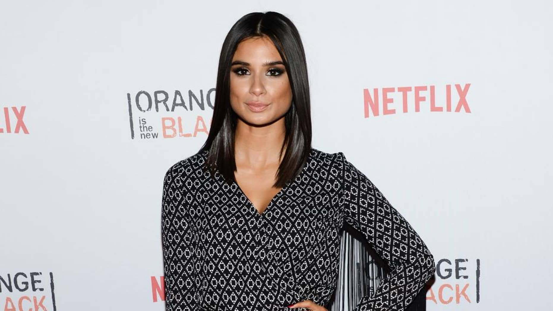 """FILE- IN this June 11, 2015, file photo, actress Diane Guerrero attends Netflix's """"Orange is the New Black"""" ORANGECON Celebration at Skylight Clarkson SQ in New York. The depression, the anxiety and the emotional instability that Guerrero went through due to the separation from her parents are some of the points she writes about in her new memoir """"In the Country We Love: My Family Divided,"""" as well as her later professional development and her work in the successful Netflix series """"Orange Is The New Black"""" and The CW's """"Jane The Virgin."""" (Photo by Evan Agostini/Invision/AP)"""