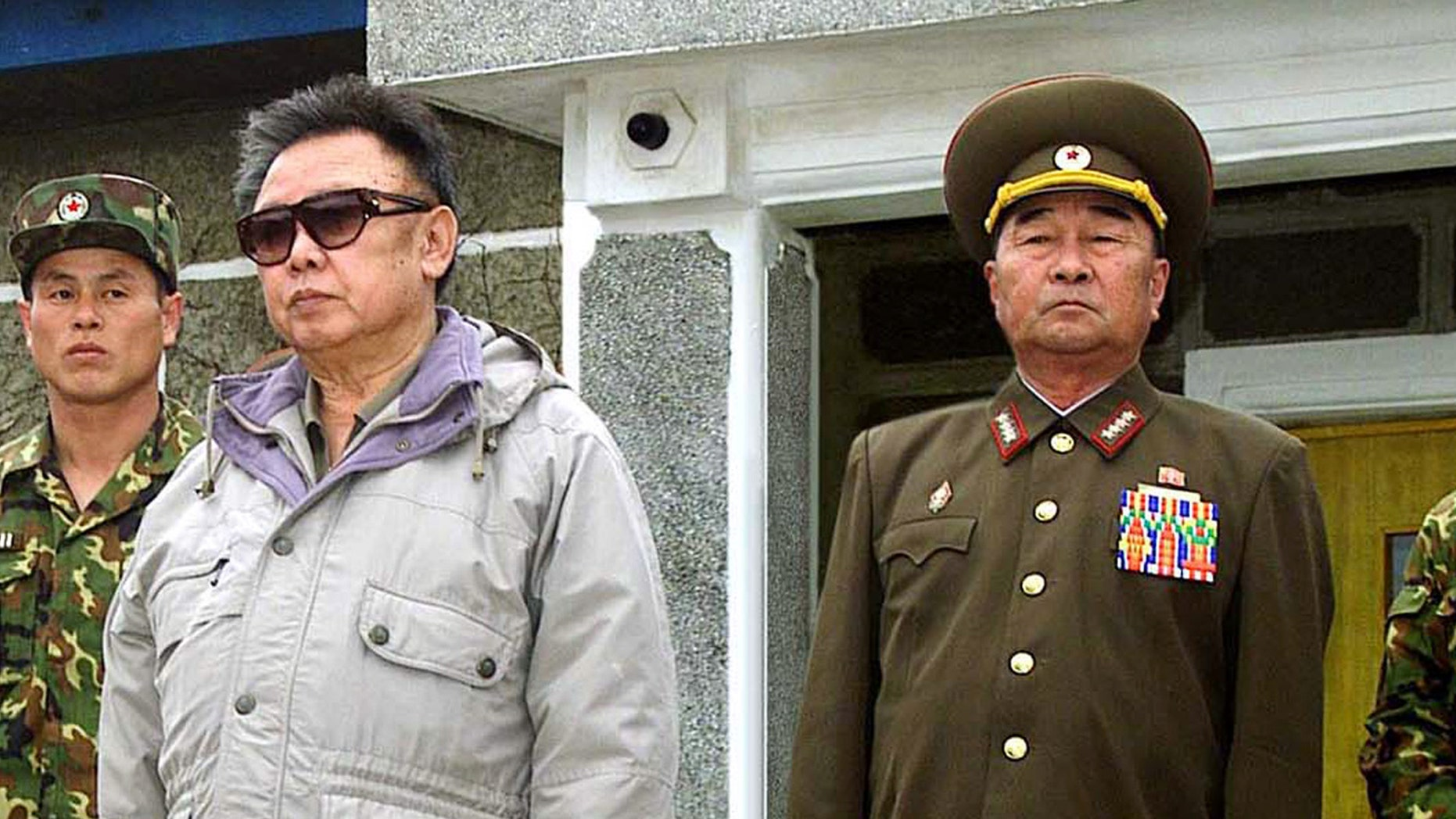 FILE - In this April 23, 2007 file photo released by Korean Central News Agency via Korea News Service in Tokyo, Gen. Kim Kyok Sik, right, stands with then-North Korean leader Kim Jong Il during the leader's inspection of Korean People's Army Unit 1637 at an undisclosed location in North Korea. North Korea replaced hard-line defense chief Kim Kyok Sik with little-known army general Jang Jong Nam. Mention of Jang's new role was buried Monday, May 13, 2013 in a state media dispatch listing those who attended an art performance with leader Kim Jong Un. (AP Photo/Korean Central News Agency via Korea News Service, File)