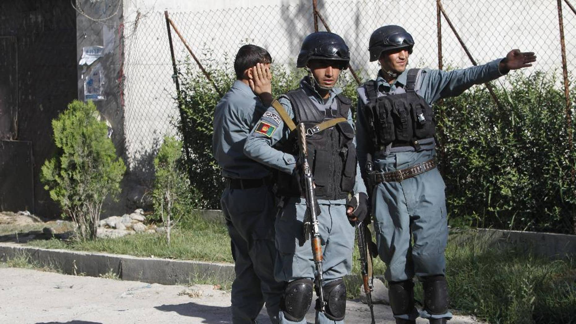 """May 27, 2015: Afghanistan security forces inspect the site of attack in Kabul, Afghanistan. Afghan officials say there are """"no civilian or military casualties"""" following an all-night siege in an upscale neighborhood in the capital Kabul. Taliban attackers targeted a guesthouse in a six-hour assault."""