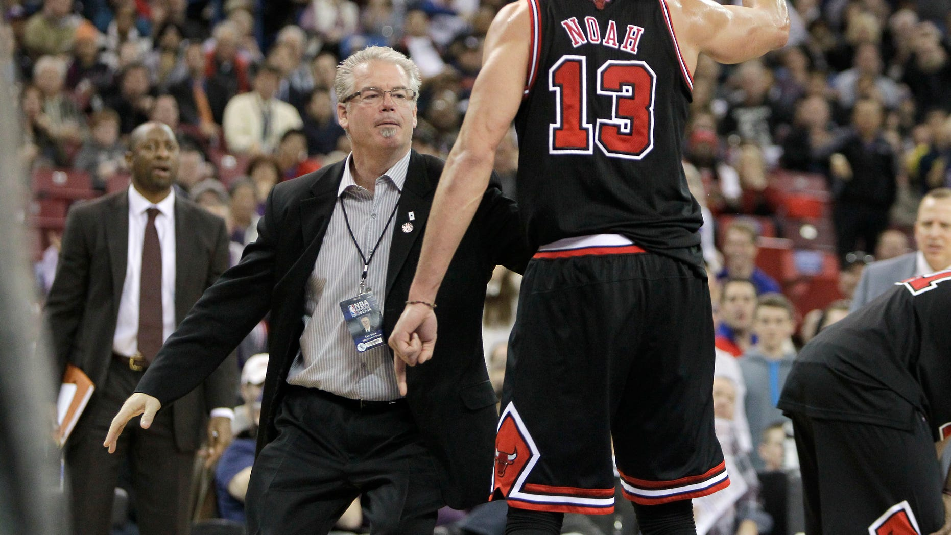 Chicago Bulls center Joakim Noah is restrained by Bulls security agent Eric Buck, after he was given his second technical foul and was ejected from the game in the third quarter against the Sacramento Kings in a NBA basketball game in Sacramento, Calif., Monday, Feb. 3, 2014. The Kings won 99-70. (AP Photo/Rich Pedroncelli)