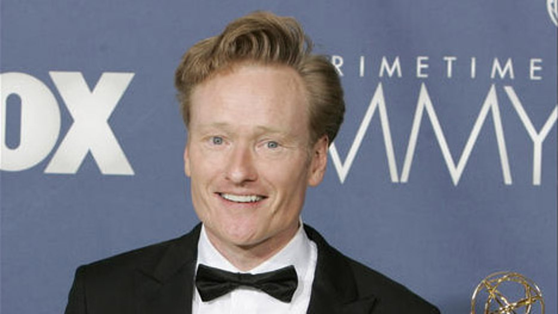 "Conan O'Brien holds the awards for outstanding writing for a variety, music or comedy program for ""Late Night with Conan O'Brien"" the 59th Primetime Emmy Awards Sunday, Sept. 16, 2007, in Los Angeles.  (AP Photo/Chris Carlson)"
