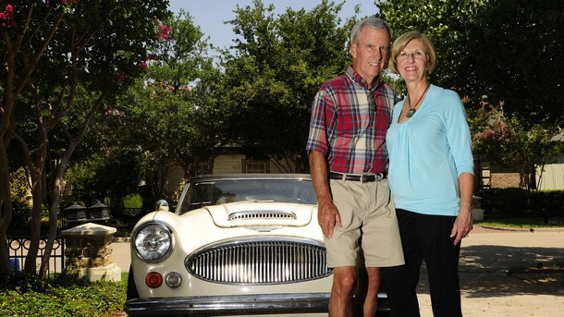 FILE: Bob Russell, right, and his wife Cyndy, pose in front of their 1967 Austin Healy, outside their Southlake, Texas home.