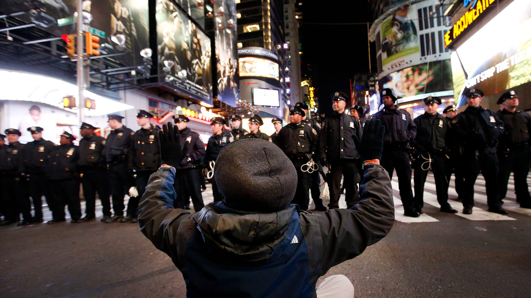 A protester on 42nd Street near Times Square, Thursday, Dec. 4, 2014, in New York.