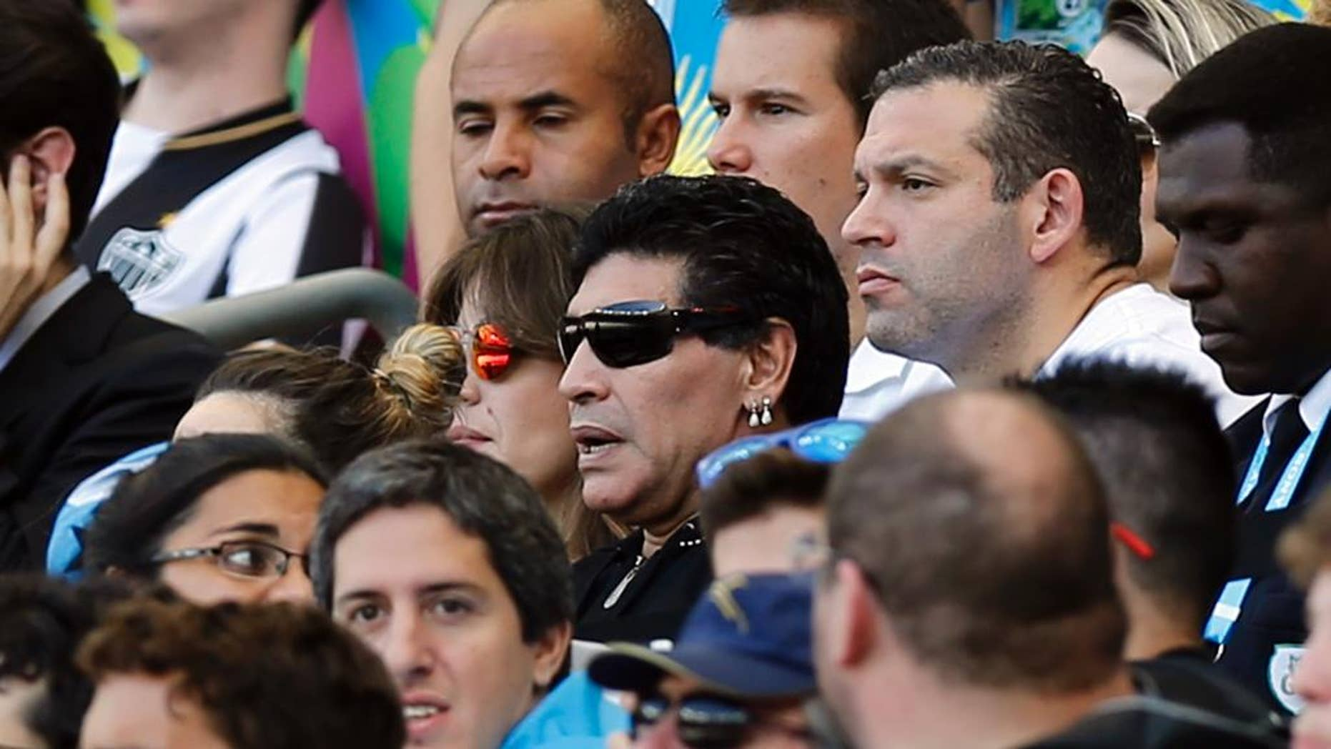 Argentine soccer legend Diego Maradona watches the group F World Cup soccer match between Argentina and Iran at the Mineirao Stadium in Belo Horizonte, Brazil, Saturday, June 21, 2014. (AP Photo/Victor R. Caivano)