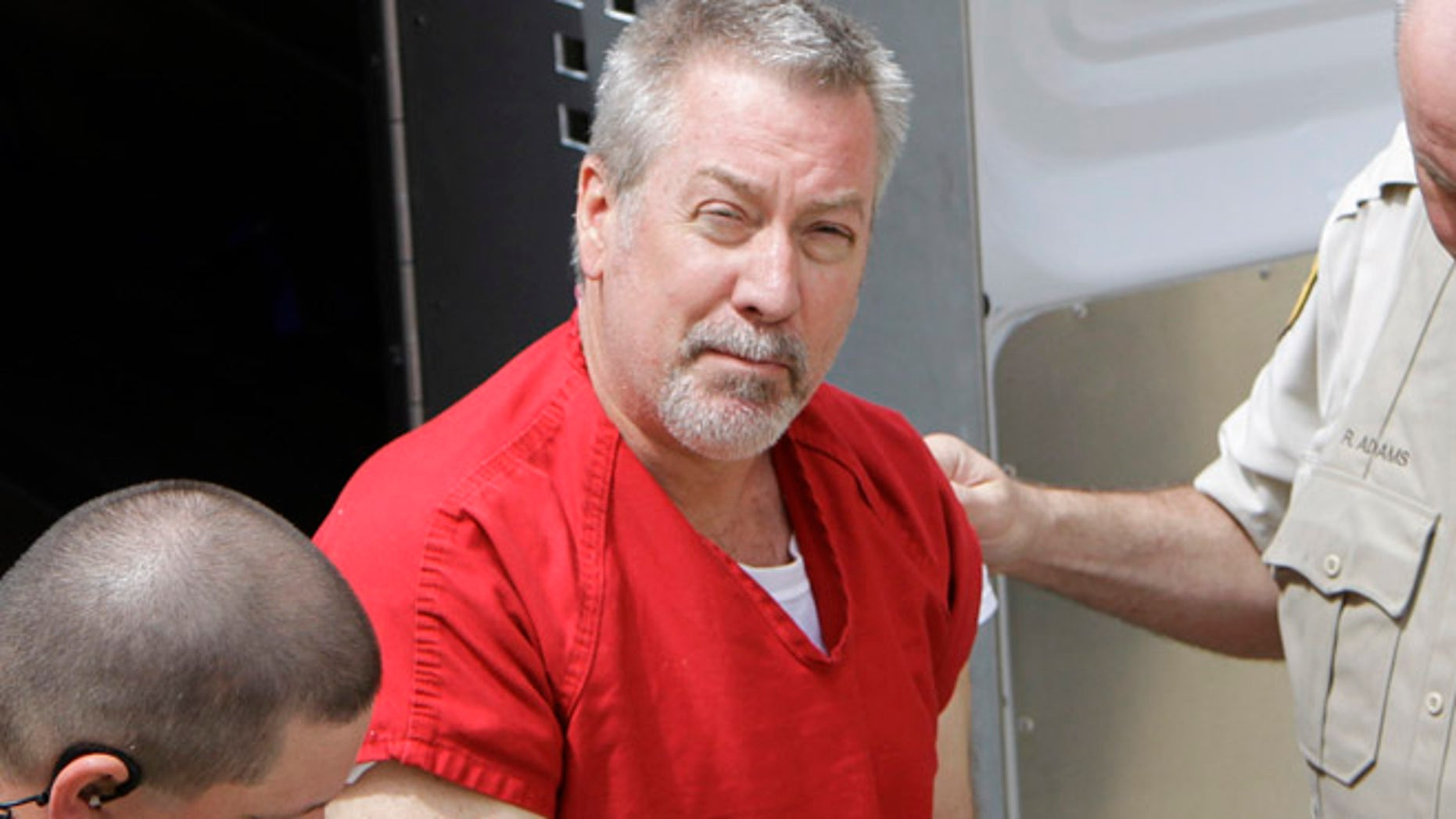 """Drew Peterson, seen here in 2009, was convicted last year of killing his third wife, but that didn't stop three male pen pals from reportedly contacting the former cop. """"Not only are they writing him letters, but they are putting money into his prison spending account so he can buy extra food for himself in the prison commissary like Skittles and popcorn,"""" a source close to Peterson told the Chicago Sun-Times last year. (AP)"""