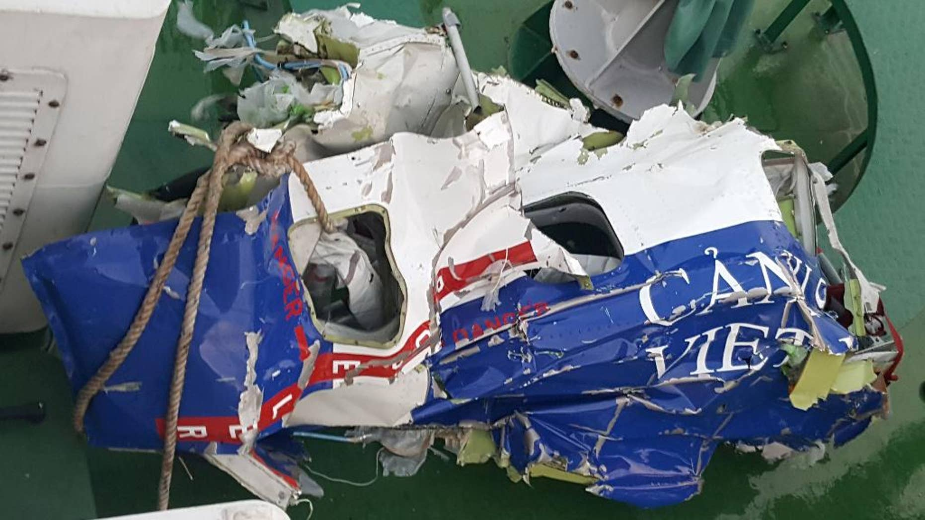 The wreckage of a maritime patrol aircraft that went missing is seen on a maritime police vessel off the coast of northern port city of Hai Phong, Vietnam, Friday, June 17, 2016.  Vietnamese rescuers have found some pieces belonging to a search plane that went missing with nine people aboard while attempting to locate a pilot from a crashed fighter jet, the military said Friday. (Hong Pha/Vietnam News Agency via AP)