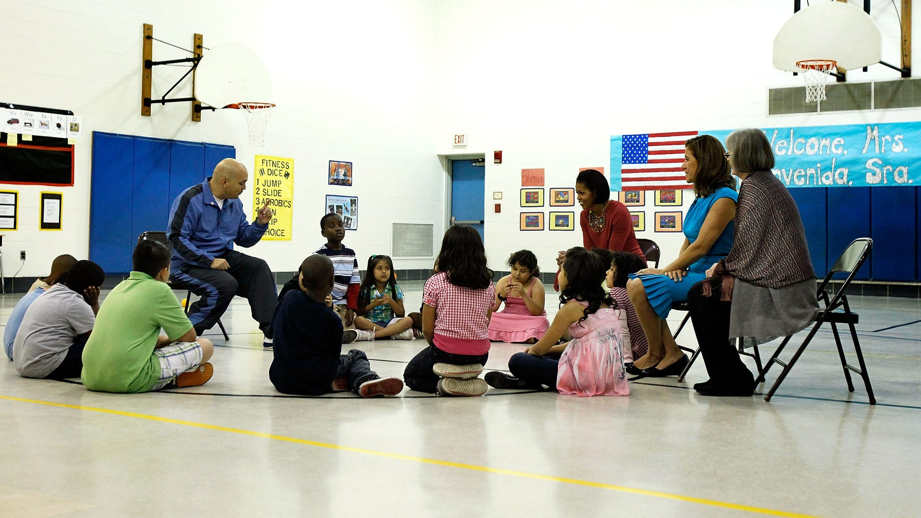 SILVER SPRING, MD - MAY 19:  U.S. first lady Michelle Obama (3rd R) and her Mexican counterpart Margarita Zavala (2nd R) listen to PE teacher Thomas Ryan (L) during a physical education class as they visit New Hampshire Estates Elementary School,  which was awarded the USDA?s Healthier US School Challenge Silver Award in 2009 and partnered with a school in Mexico as part of the Monarch Butterfly Sister School Program,  May 19, 2010 in Silver Spring, Maryland. President of Mexico Felipe Calderon is on a state visit to Washington with the first lady of Mexico.  (Photo by Alex Wong/Getty Images)
