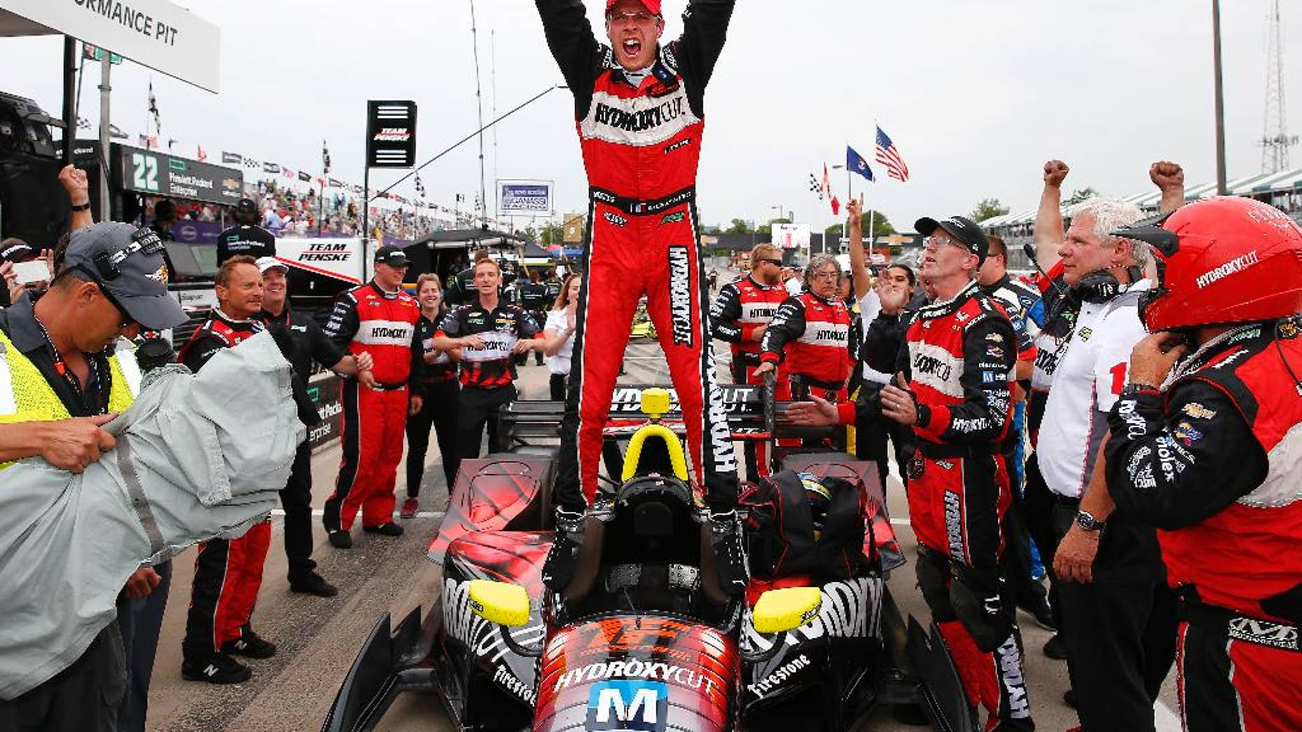 """FILE - In this June 4, 2016 file photo, Sebastien Bourdais, of France, celebrates winning race one of the IndyCar Detroit Grand Prix auto racing double header on Belle Isle in Detroit.  Bourdais speaks reverently about the Le Mans 24 Race in his native France, as if some mythical force has a hand in the competition. """"I don't know what's the criteria ... All I can tell you is Le Mans picks its winner,"""" Bourdais said. If that's the case, this year, the race finally picked him.  (AP Photo/Paul Sancya, File)"""