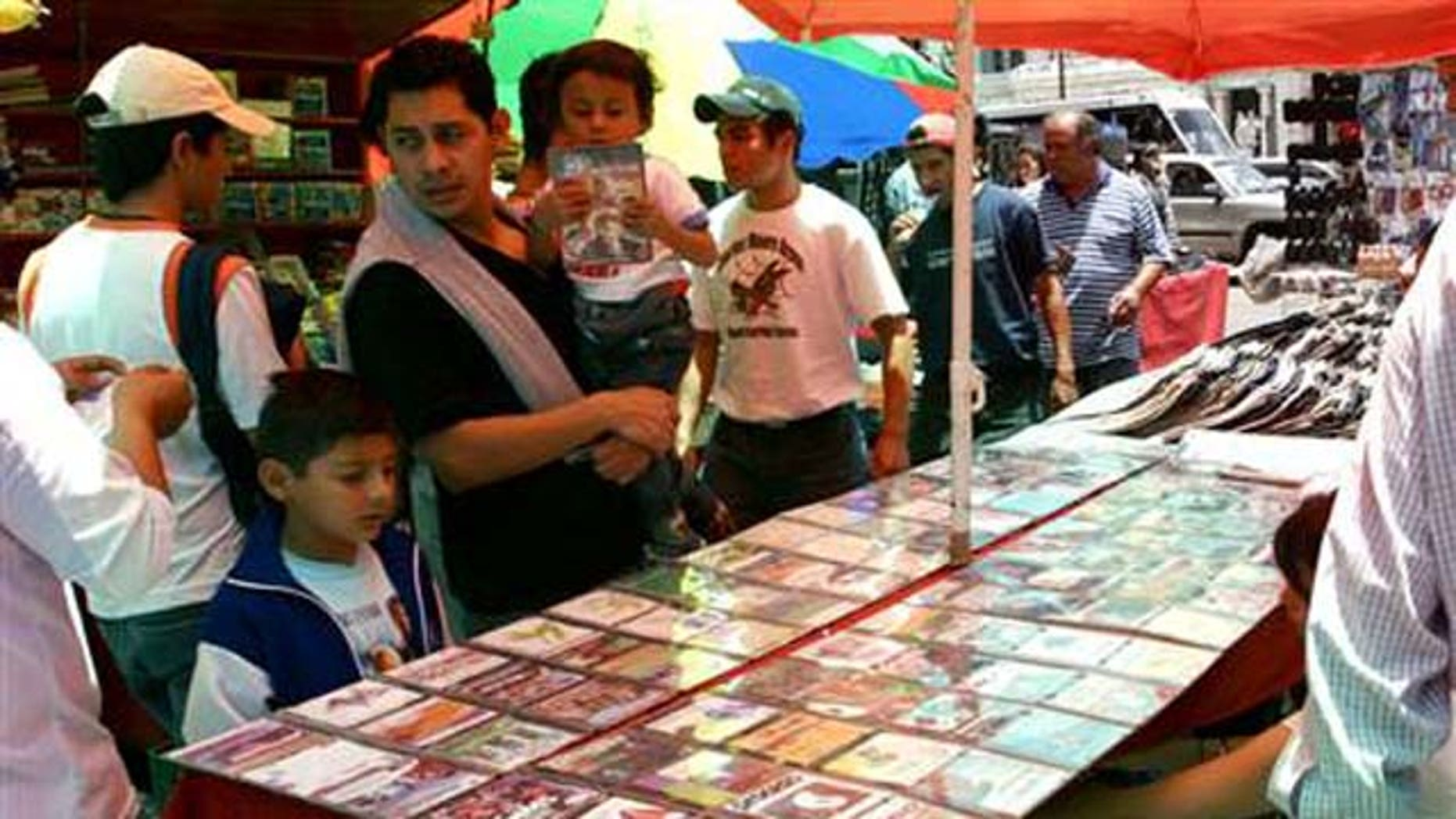 June 27, 2006: People shop for pirated CD's in downtown Mexico City.