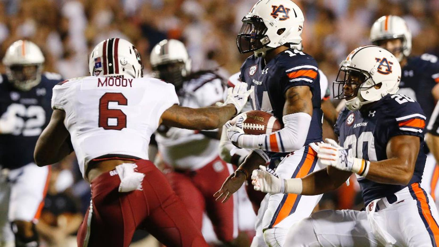 Auburn quarterback Nick Marshall (14) runs the ball in for a touchdown against South Carolina during the second half of an NCAA college football game Saturday, Oct. 25, 2014, in Auburn, Ala. Auburn won 42-35. (AP Photo/Brynn Anderson)