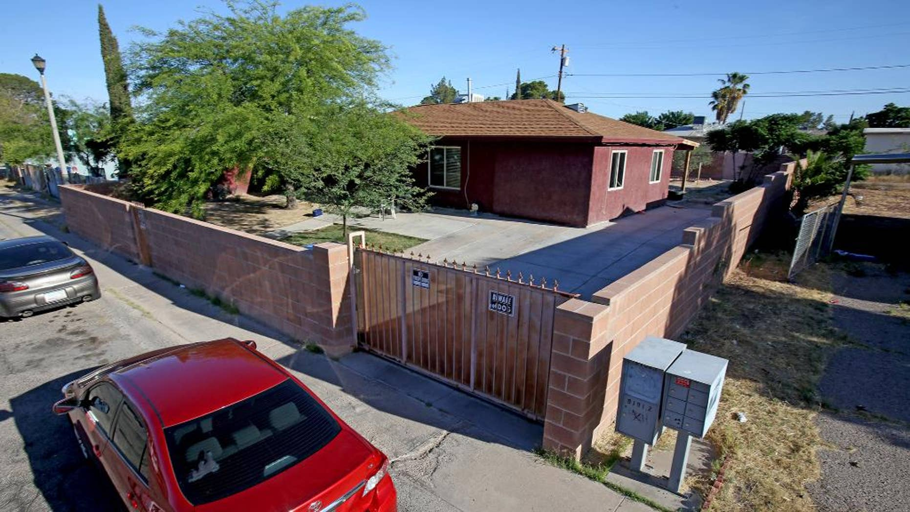 """Police say five people were shot to death in a reported murder-suicide Tuesday evening at this home on the 800 block of West Calle Medina, Tucson, Ariz., shown Wednesday, May 13, 2015. Police got word of the bloodshed from a man who went to the house to meet someone, """"peeked inside and noticed one individual who appeared to be deceased with multiple gunshot wounds,"""" police Sgt. Pete Dugan said. (A.E. Araiza/Arizona Daily Star via AP)  ALL LOCAL TELEVISION OUT; PAC-12 OUT; MANDATORY CREDIT; GREEN VALLEY NEWS OUT; MANDATORY CREDIT"""