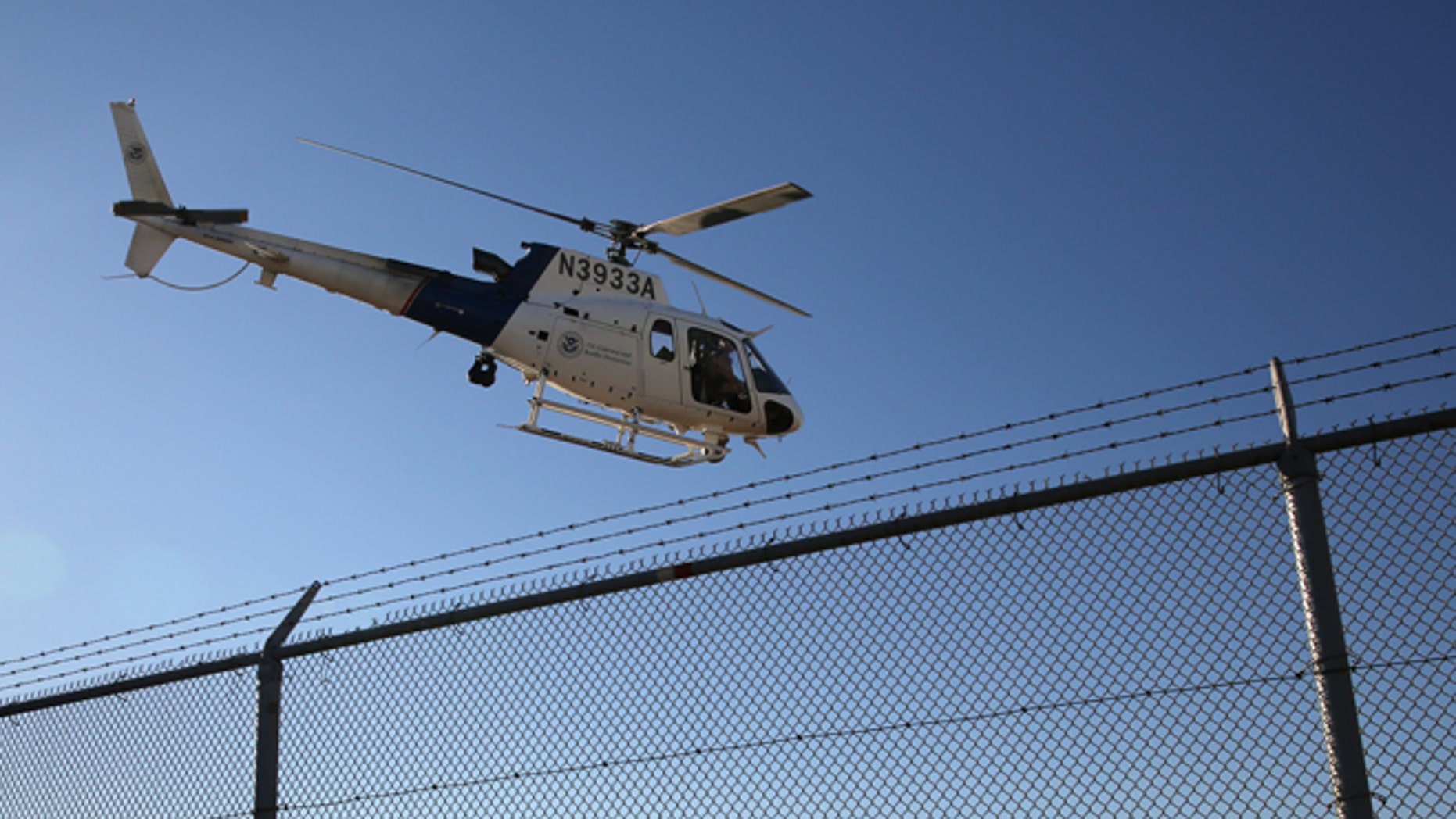 SAN DIEGO, CA - OCTOBER 01:  A U.S. Office of Air and Marine (OAM) helicopter patrols near the U.S.-Mexico border on October 1, 2013 in San Diego, California. OAM helicopters support U.S. Border Patrol as well as Immigration and Customs Enforcement (ICE), personnel protecting border areas. While much of the Federal Government has closed down, personnel considered essential, such as border agents, remain working.  (Photo by John Moore/Getty Images)